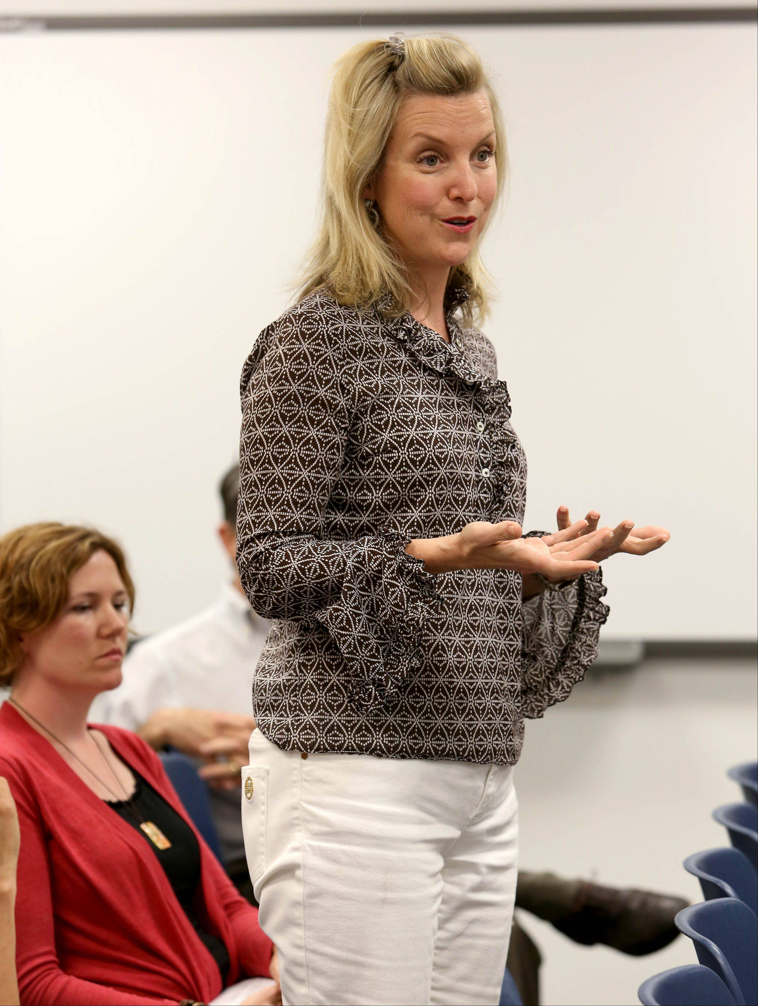 "Kim Miselnicky speaks during the Glen Ellyn District 41 school board meeting Tuesday to express her support for keeping the book ""The Perks of Being a Wallflower"" out of eighth grade classrooms."