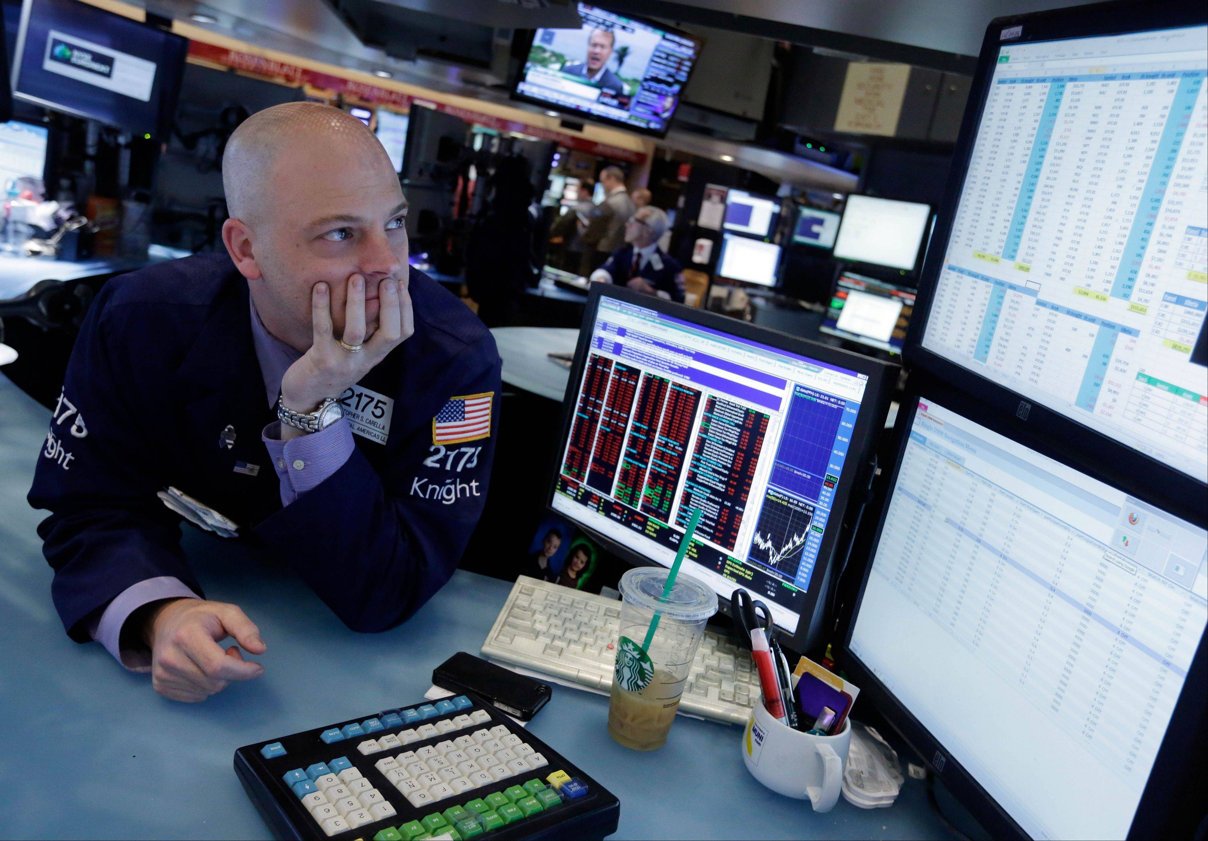 U.S. stocks fell, with the Dow Jones Industrial Average retreating from a record, amid concern that the Federal Reserve could begin to taper its debt-buying program as the economy continues to improve.