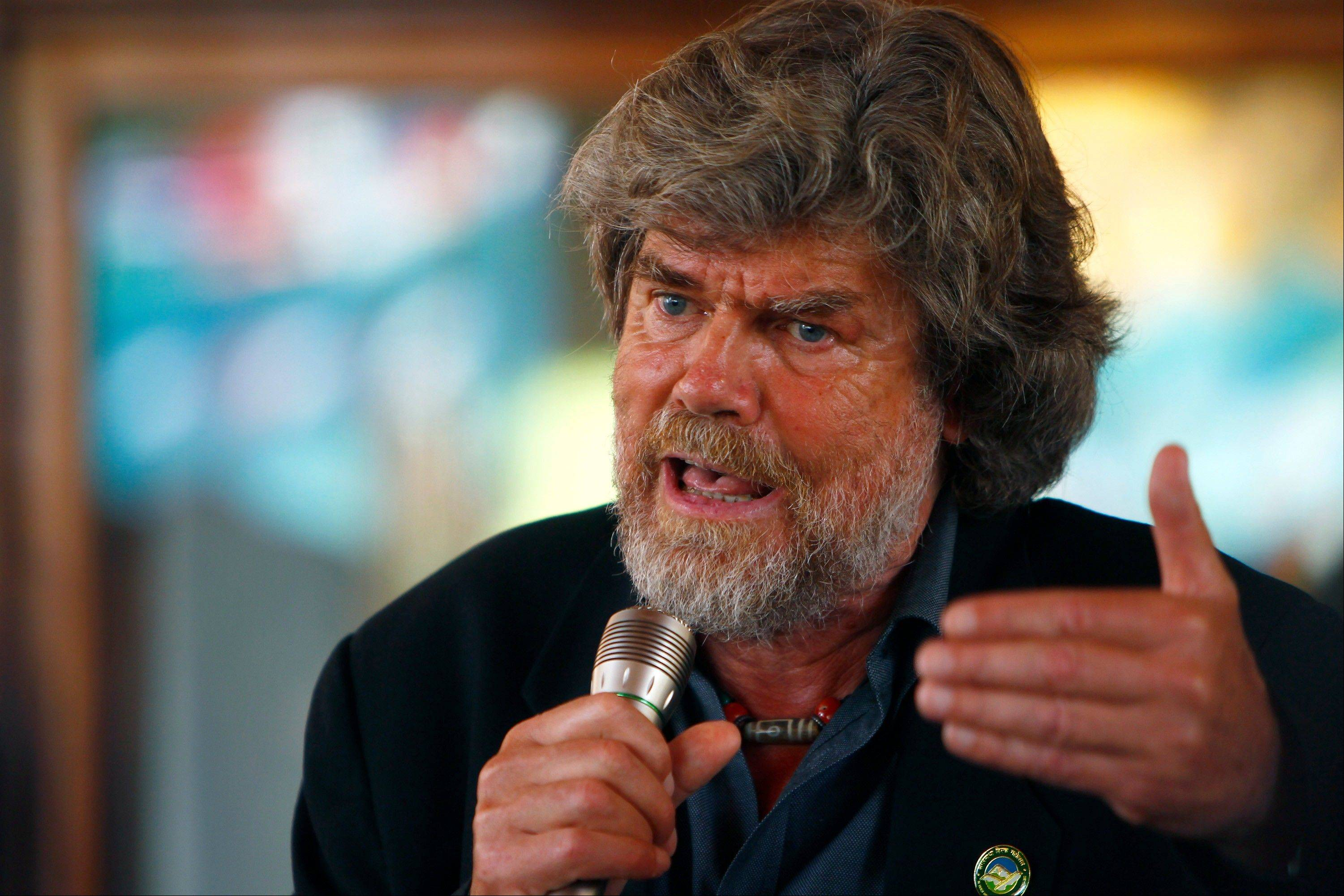 Italian Reinhold Messner, the first climber to scale Everest without using bottled oxygen and the first person to climb all of the world's 14 highest peaks, speaks at a function to mark the 60th anniversary of the conquest of Mount Everest at the British Embassy, in Katmandu, Nepal, Wednesday, May 29, 2013. Nepal celebrated the anniversary on Wednesday by honoring climbers who followed in the footsteps of Edmund Hillary and Tenzing Norgay.