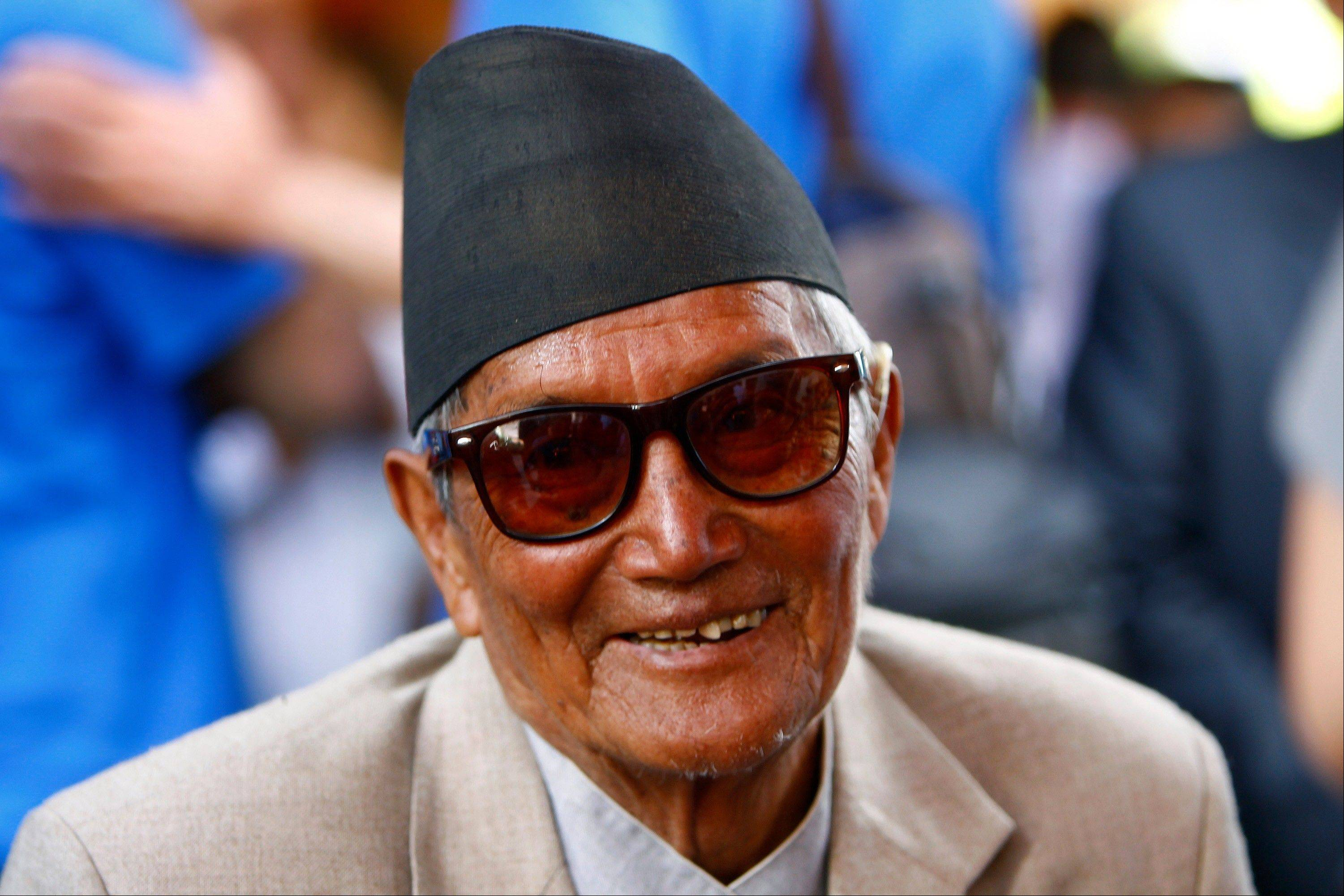 Nepalese mountaineer Min Bahadur Sherchan, 81, participates in a function to mark the 60th anniversary of the successful ascent of Mount Everest at the British Embassy, in Katmandu, Nepal, Wednesday, May 29, 2013. Sherchan had held the record for the oldest person to scale the world's highest mountain until 80-year-old Japanese climber Yuichiro Miura conquered the 8,850-meter (29,035-foot) peak last week.