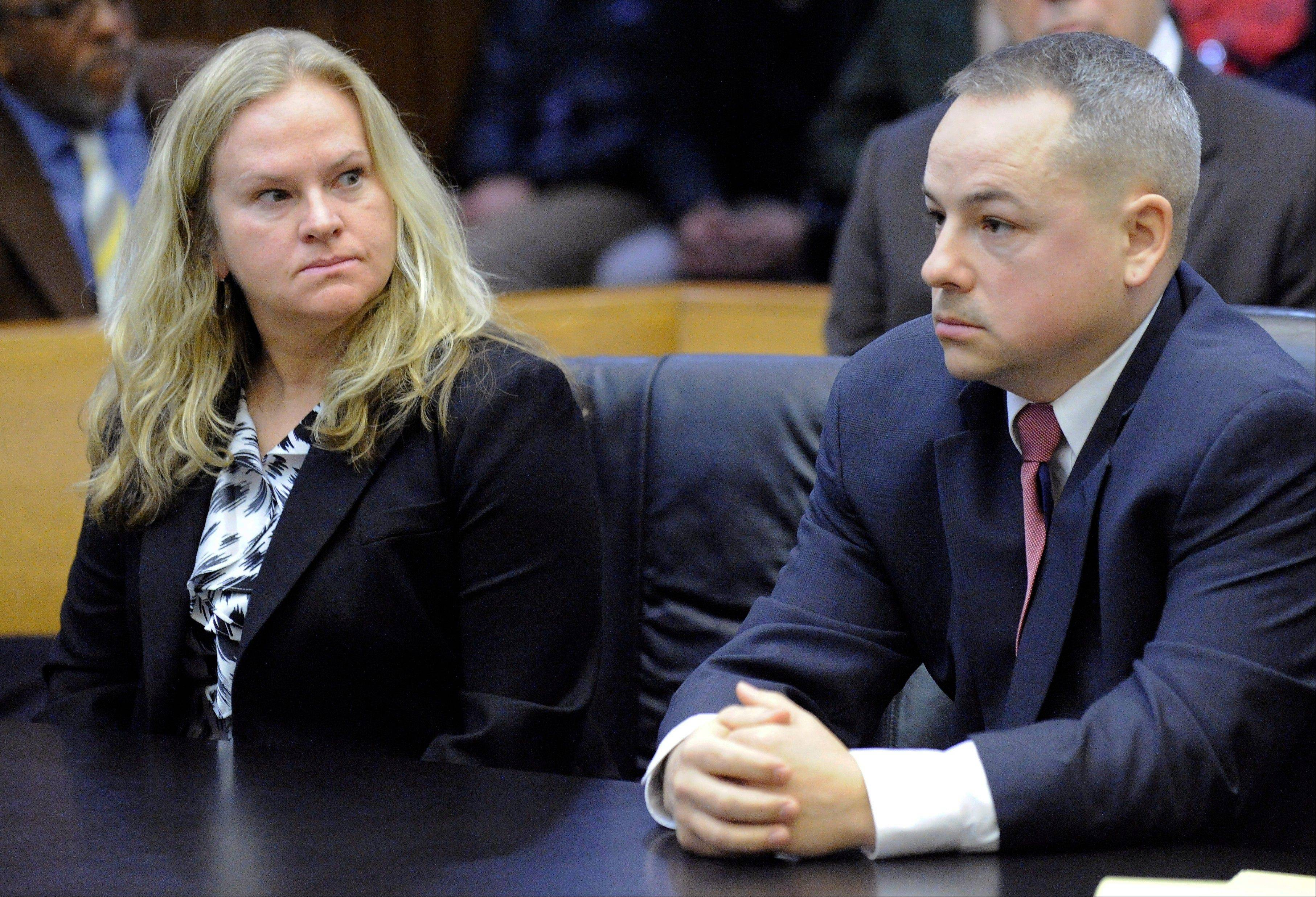 Defendant Joseph Weekely, right, and A&E producer Allison Howard, who was at the raid, sit in court before Judge Cynthia Gray Hathaway at Frank Murphy Hall of Justice in Detroit. Weekley goes on trial Wednesday, May 29, 2013. He is charged with involuntary manslaughter in the death of 7-year-old Aiyana Stanley-Jones, who died when Weekley's gun fired as police, accompanied by a reality TV crew, raided a Detroit home in search of a murder suspect in May 2010.