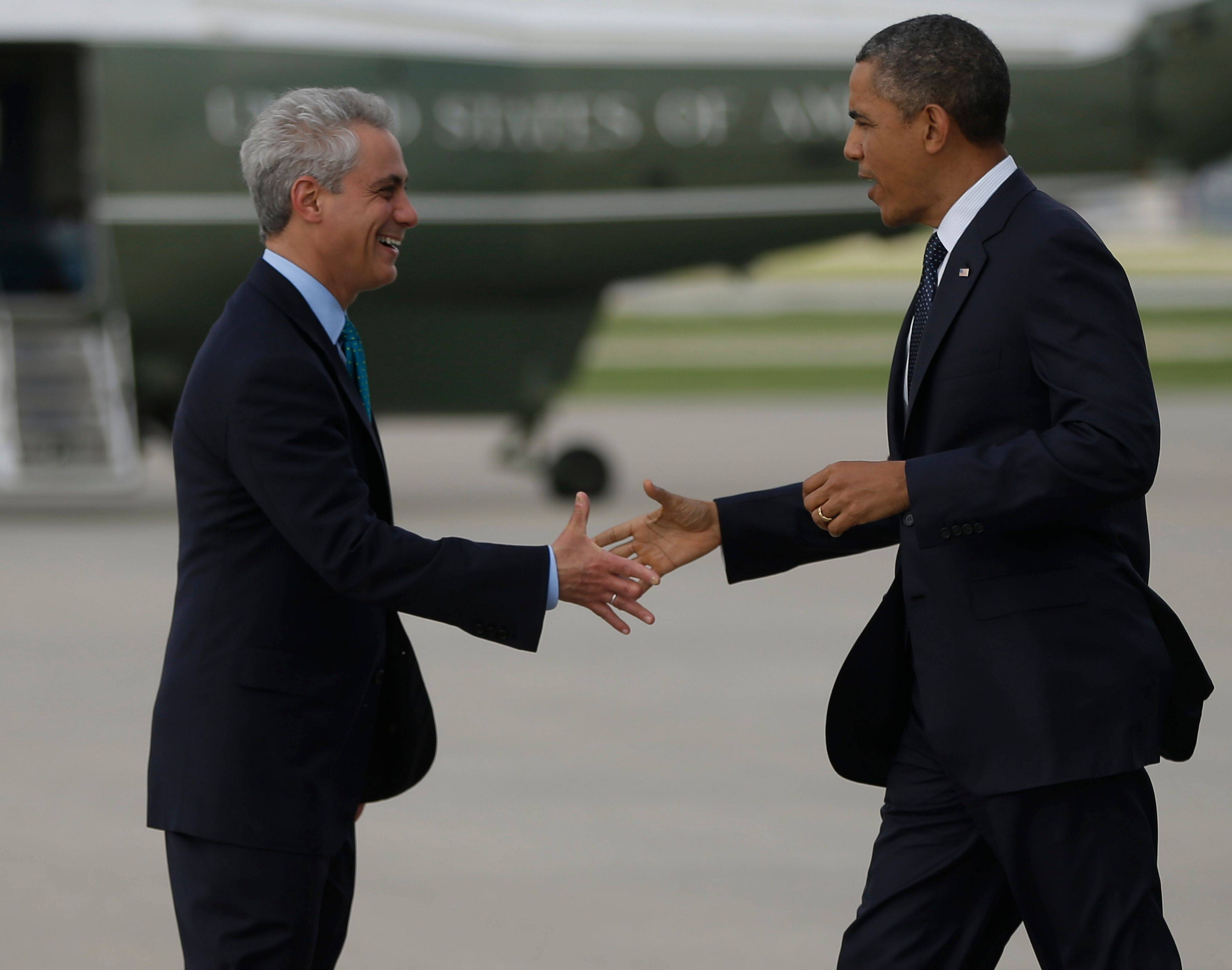 President Barack Obama is greeted by Chicago Mayor Rahm Emanuel on the tarmac upon his arrival at O'Hare International Airport Wednesday.