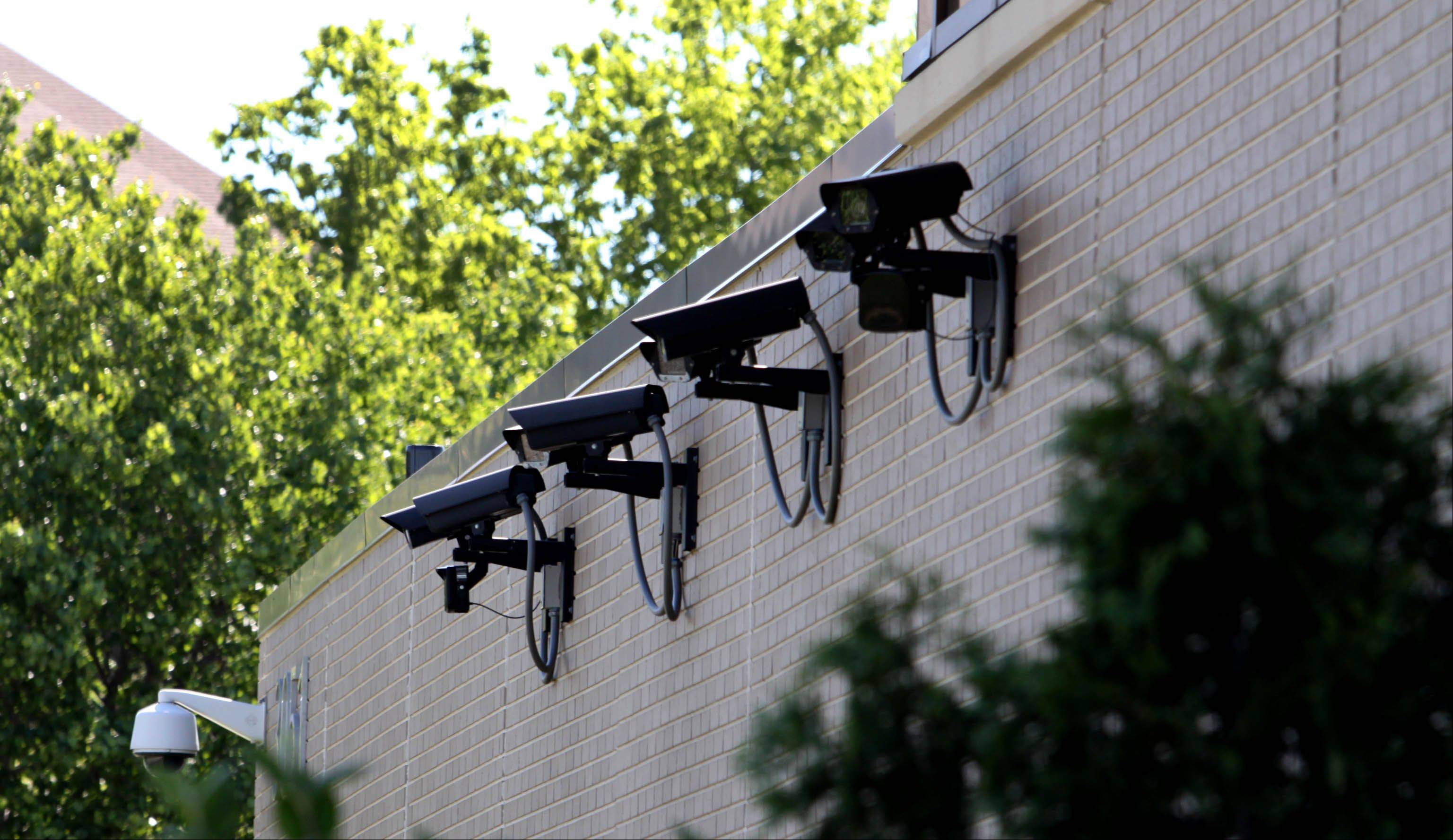 A row of security cameras are mounted at the Planned Parenthood clinic in Aurora.