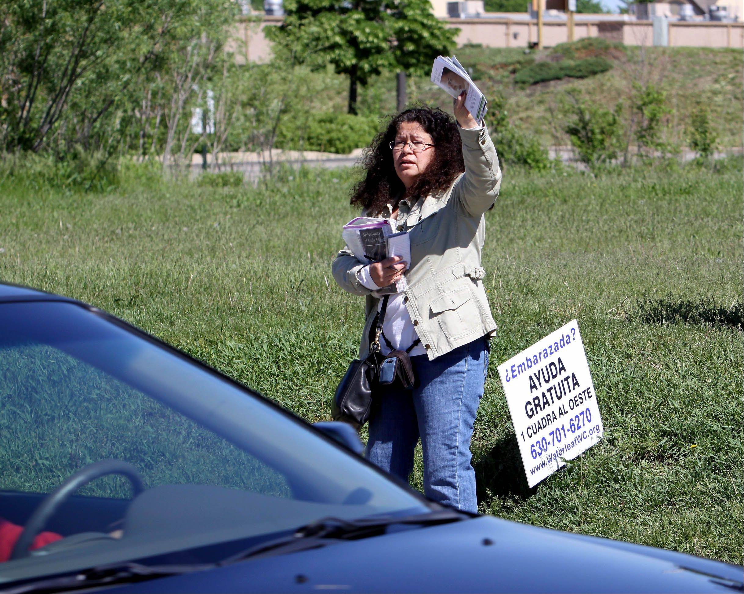 "Marie Sulita of Aurora says cars frequently swerve at her while she protests outside the Planned Parenthood clinic in Aurora. ""There are so many times that happens,"" she said, though she has never sought charges."