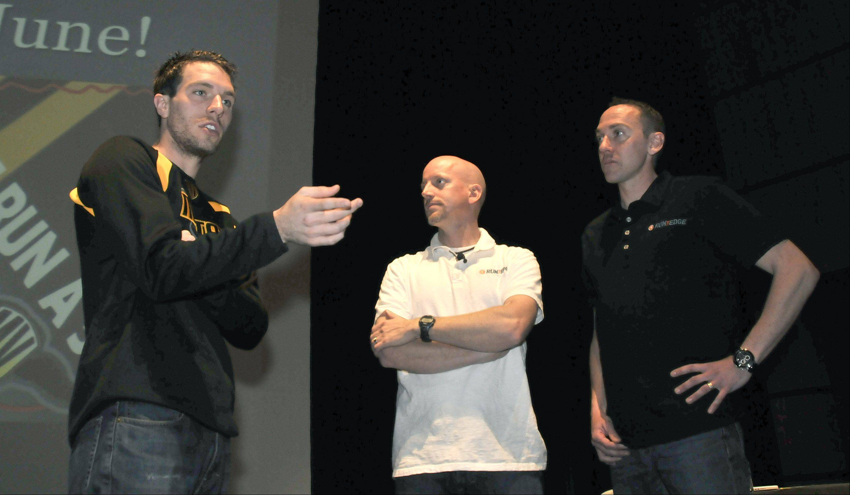 "Eric Anerino, Metea Valley English teacher and girls cross country and track coach, left, chats in April with ""Running the Edge"" authors Tim Catalano and Adam Goucher. A running and reading program centered around the book culminates Saturday with the Metea LIFE Run, a 5K that the authors will be attending."