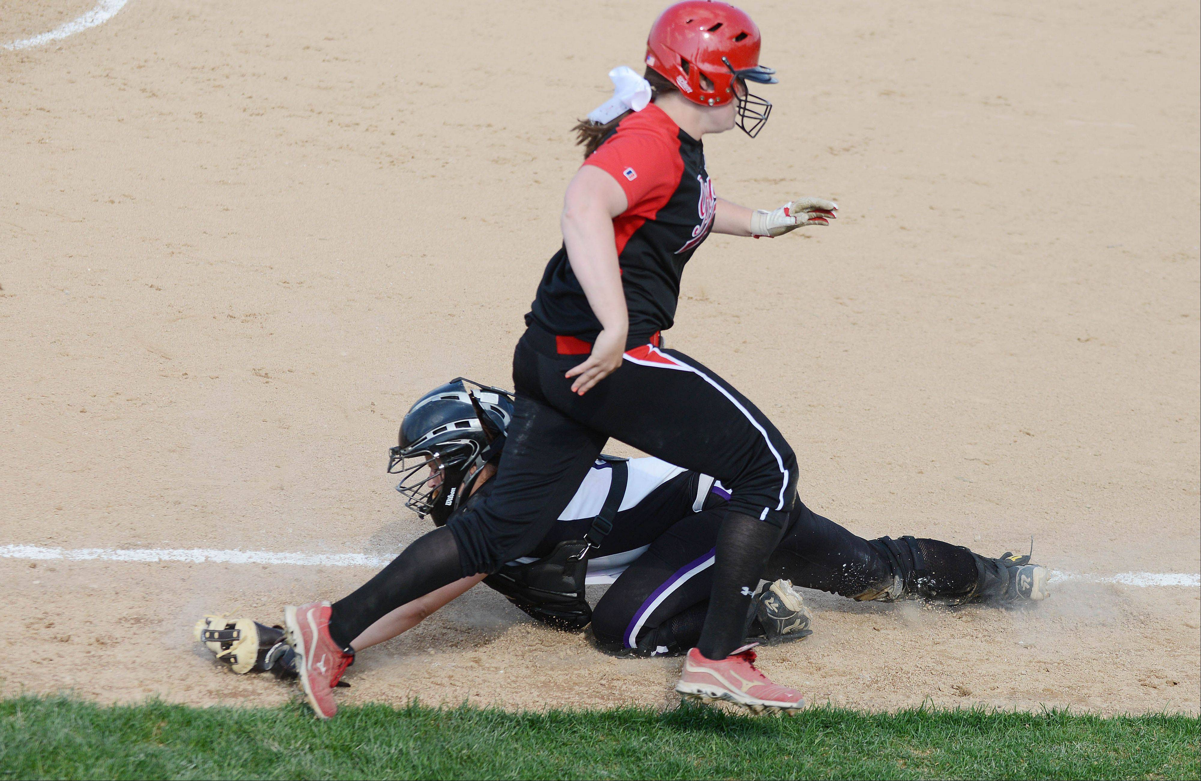 Julianne Rurka of Benet heads home while the Downers Grove North catcher reaches for the ball during the Class 4A Neuqua Valley sectional semifinals softball game Wednesday. She was safe.
