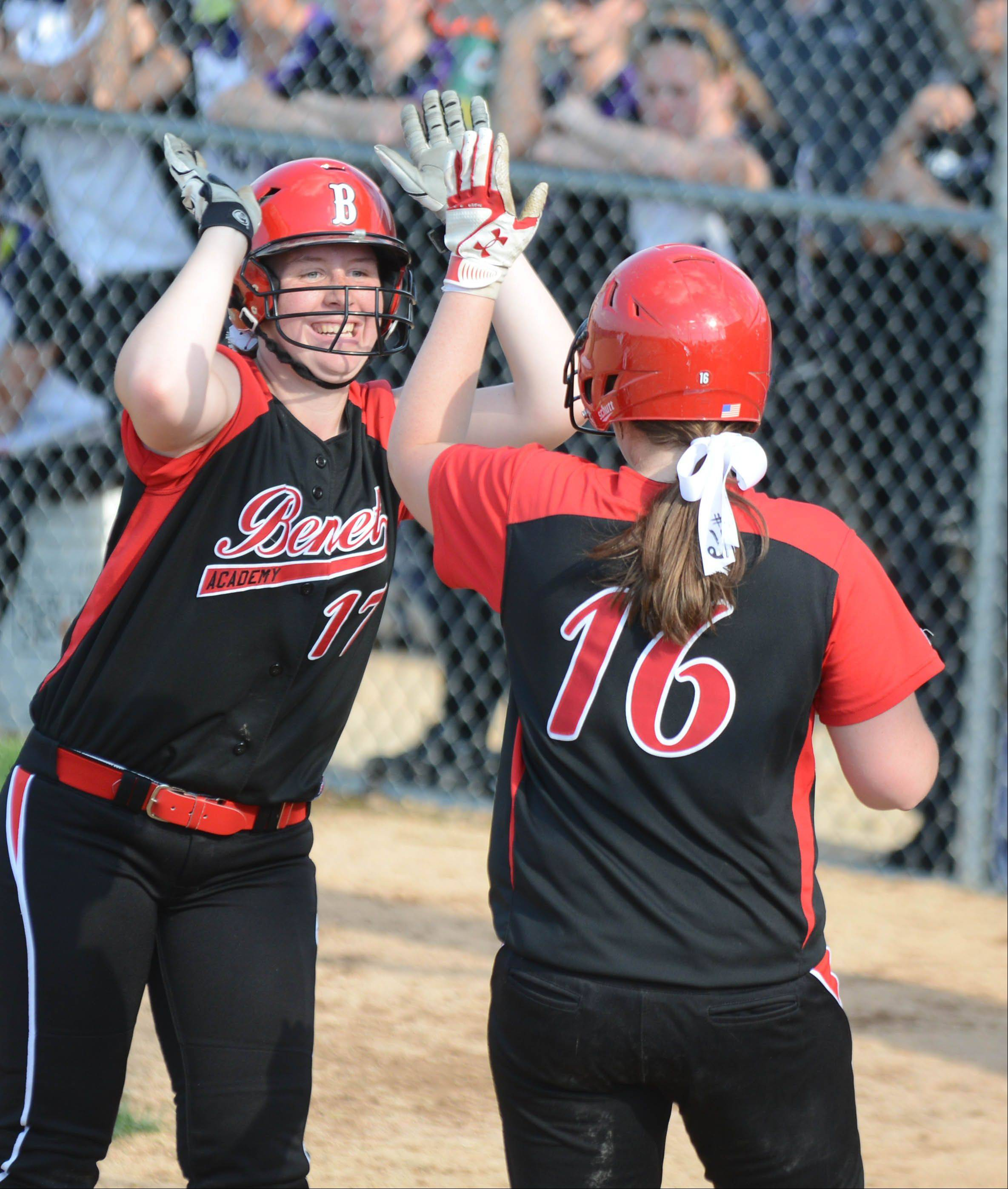 Emily York,left, and Julianne Rurka of Benet celebrate a run scored during the Class 4A Neuqua Valley sectional semifinals softball game Wednesday.