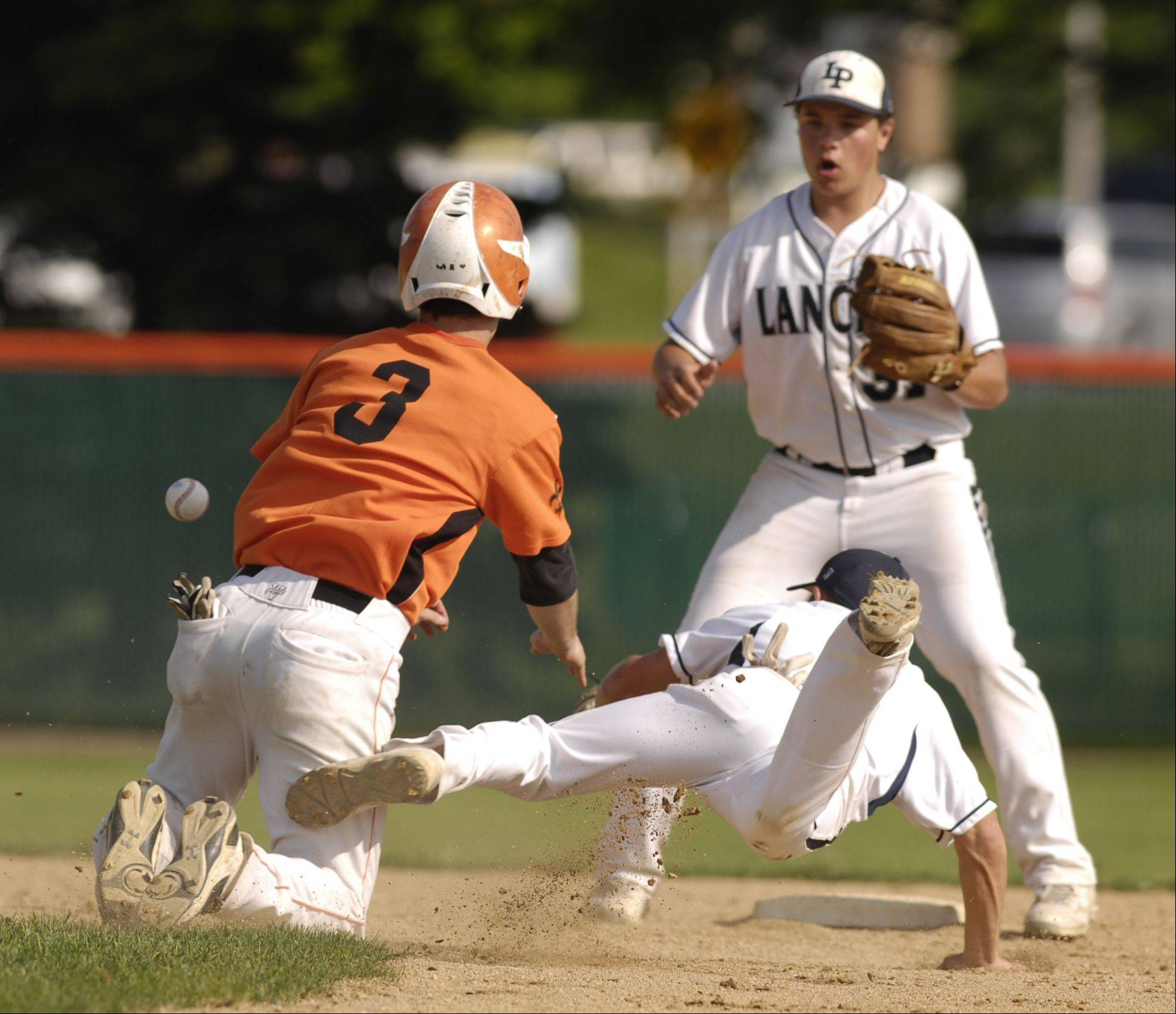 Jack Dellostritto of St. Charles East collides Sam Pellegrino of Lake Park as he heads to second during the sectional semifinals, Monday in St. Charles.