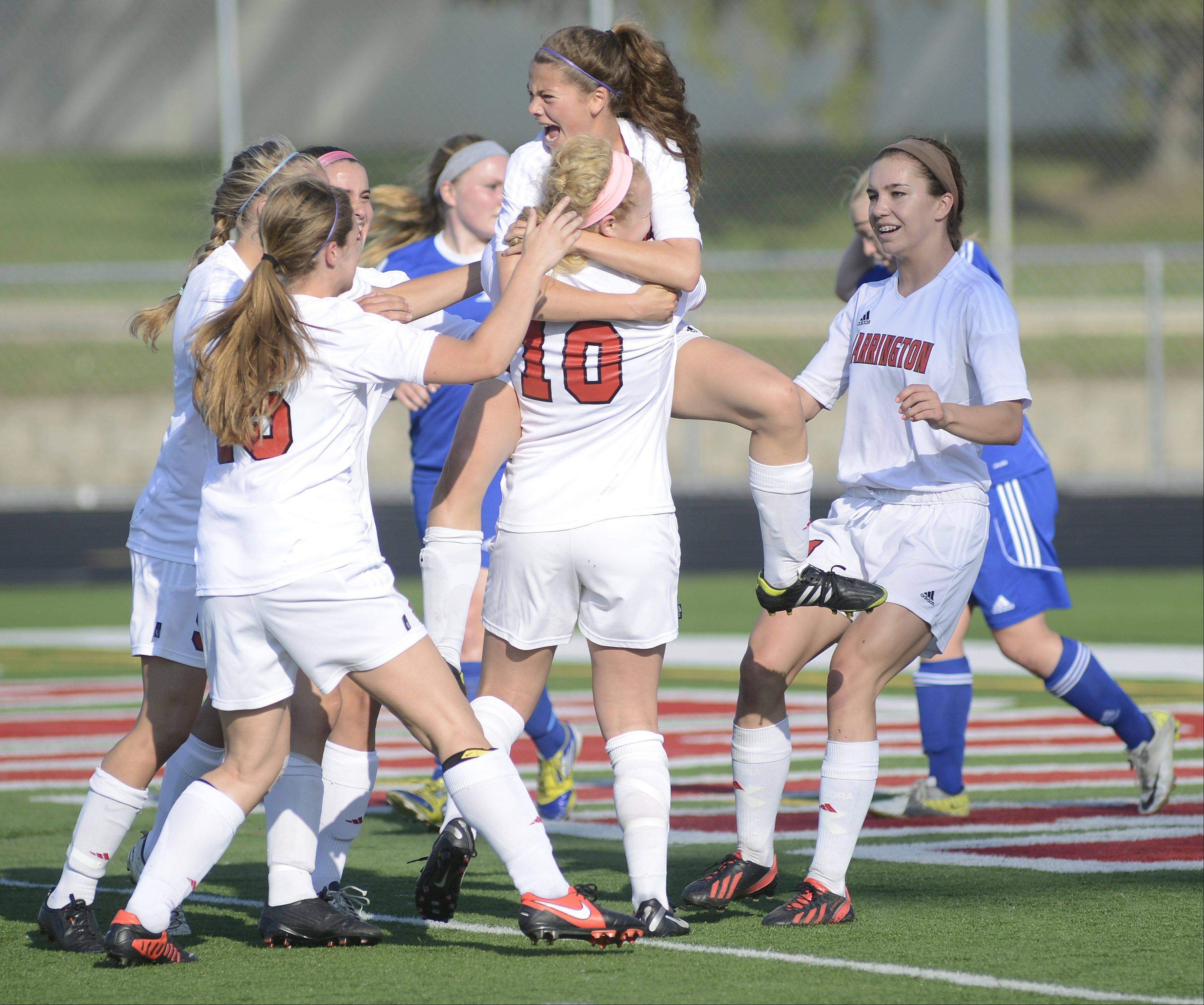 Barrington's Kelsey Muniz leaps into the arms of Molly Pfeiffer after Pfeiffer scored minutes into the first half of the Class 3A supersectional in Barrington on Wednesday.
