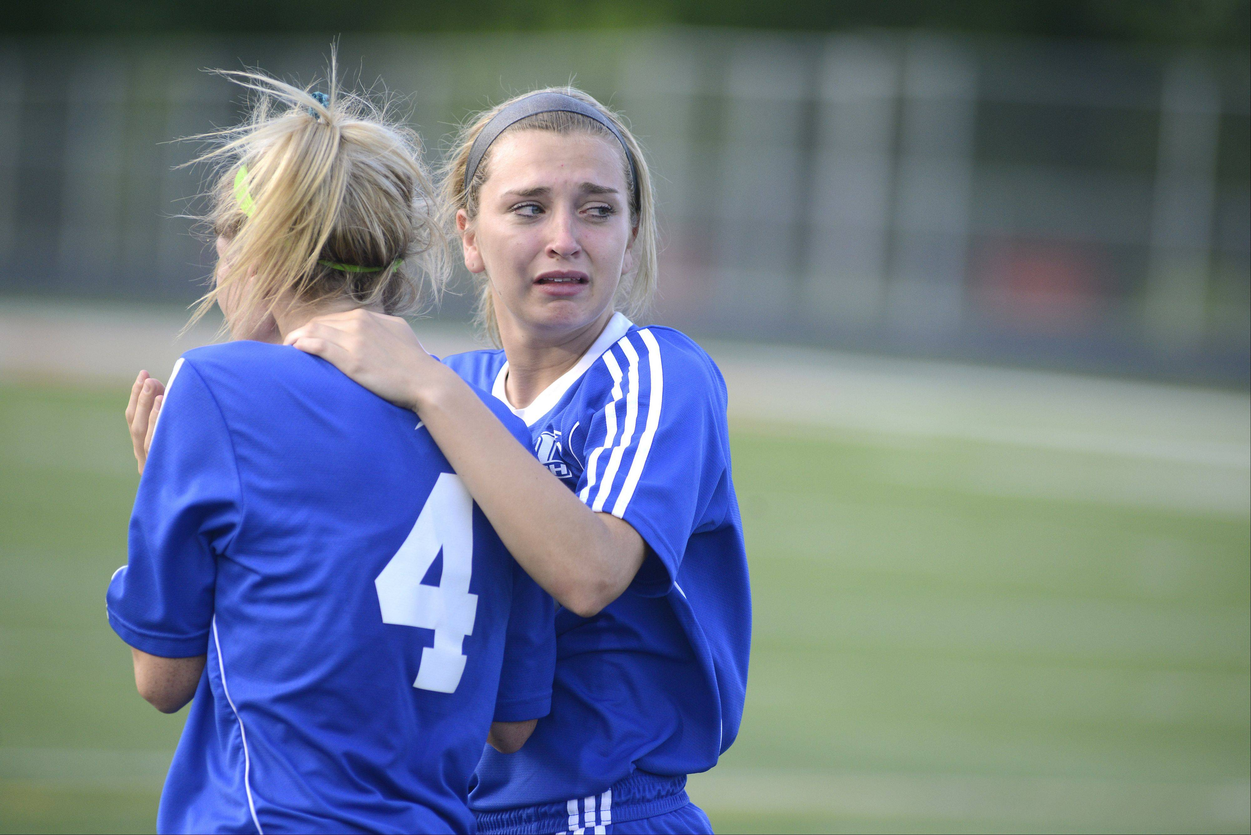 St. Charles North's Darcy Stoecklin looks back to her grieving teammates as she comforts Jenny Barr after their Class 3A supersectional loss to Barrington on Wednesday.