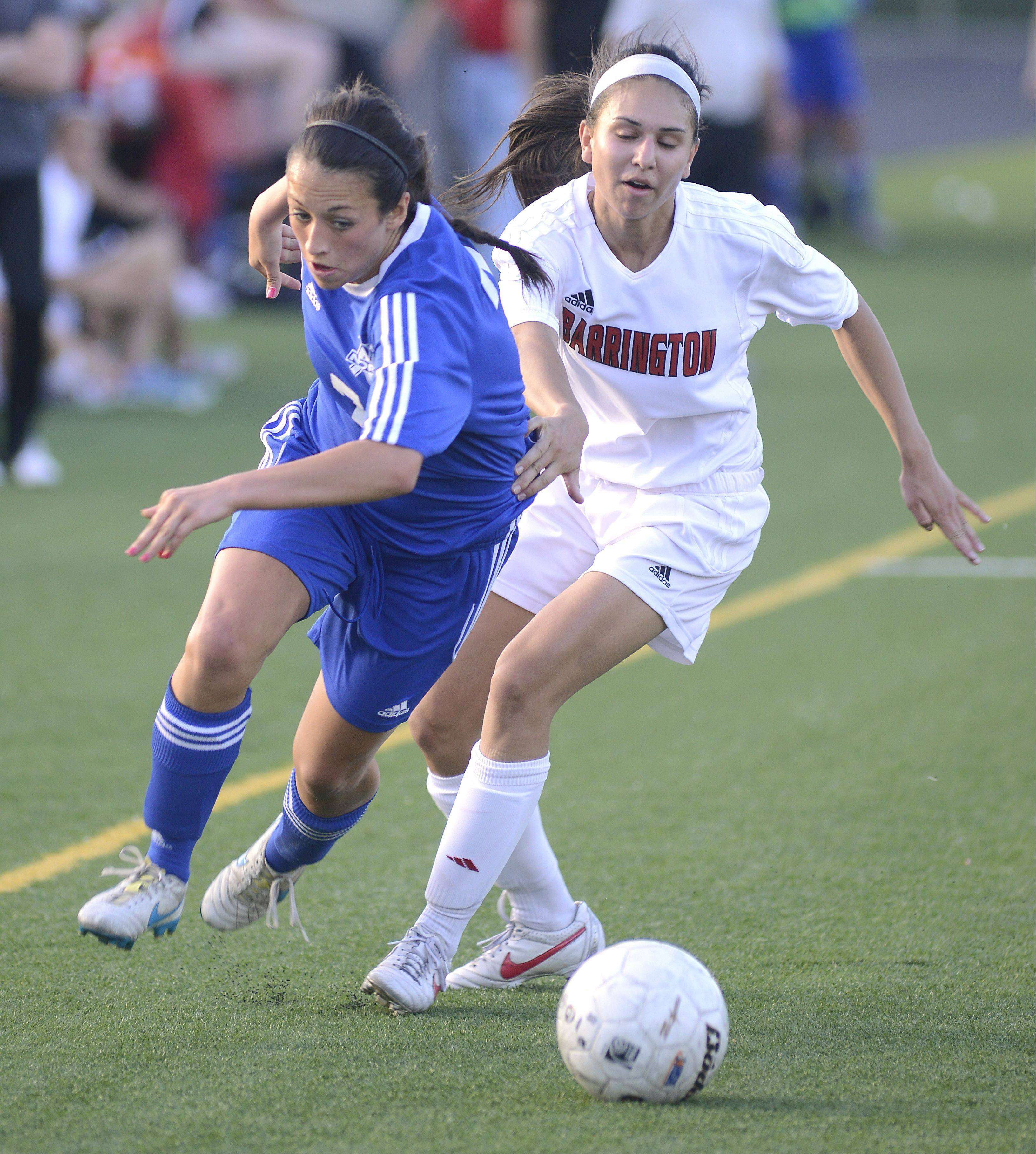 St. Charles North's Ashlyn Walter and Barrington's Aimee Pierce battle for the ball in the second half of the Class 3A supersectional in Barrington on Wednesday.