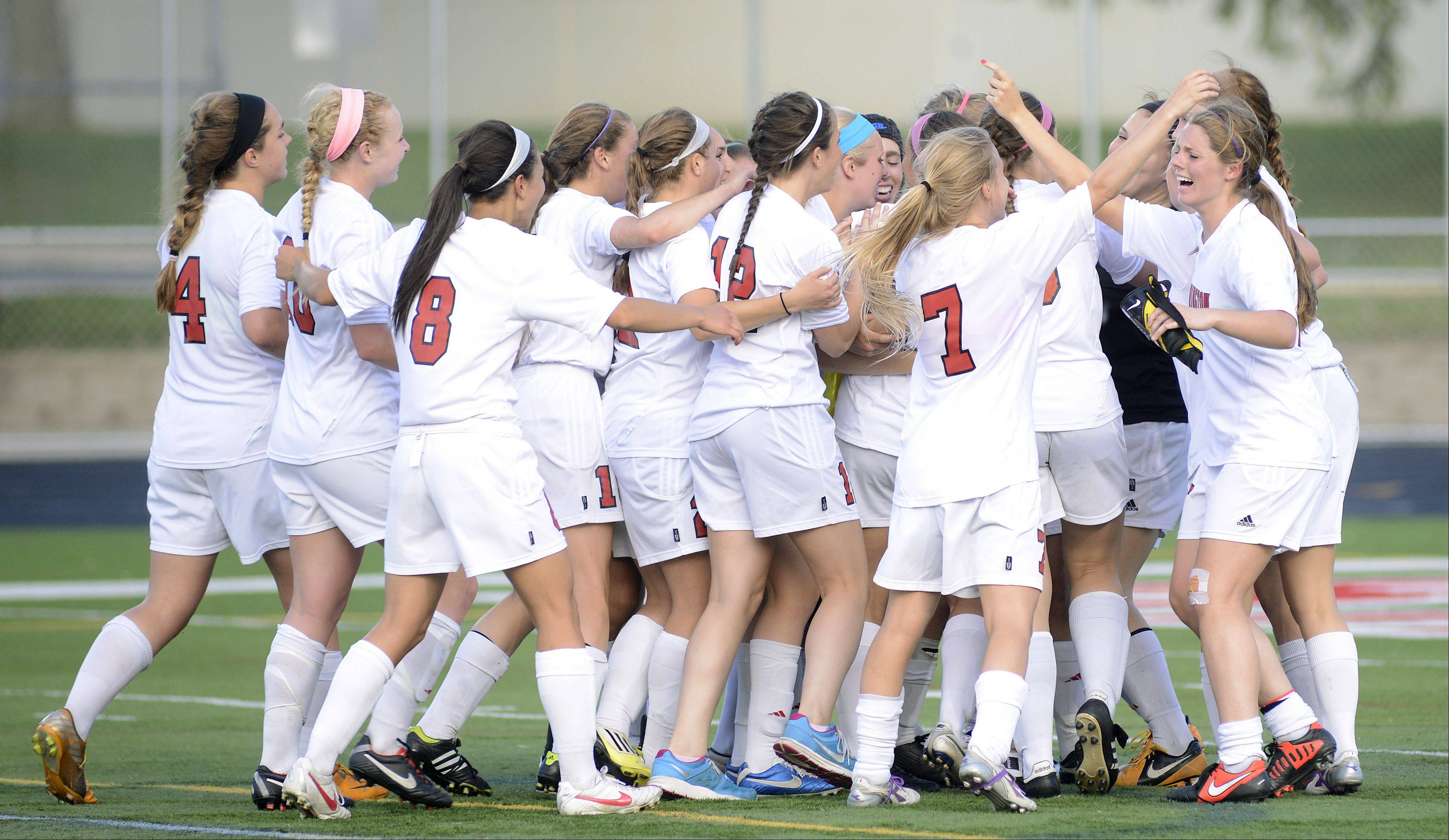 Barrington rushes the field, swarming goalie Hannah Luedtke, after the Fillies' Class 3A supersectional win over St. Charles North in Barrington on Wednesday.