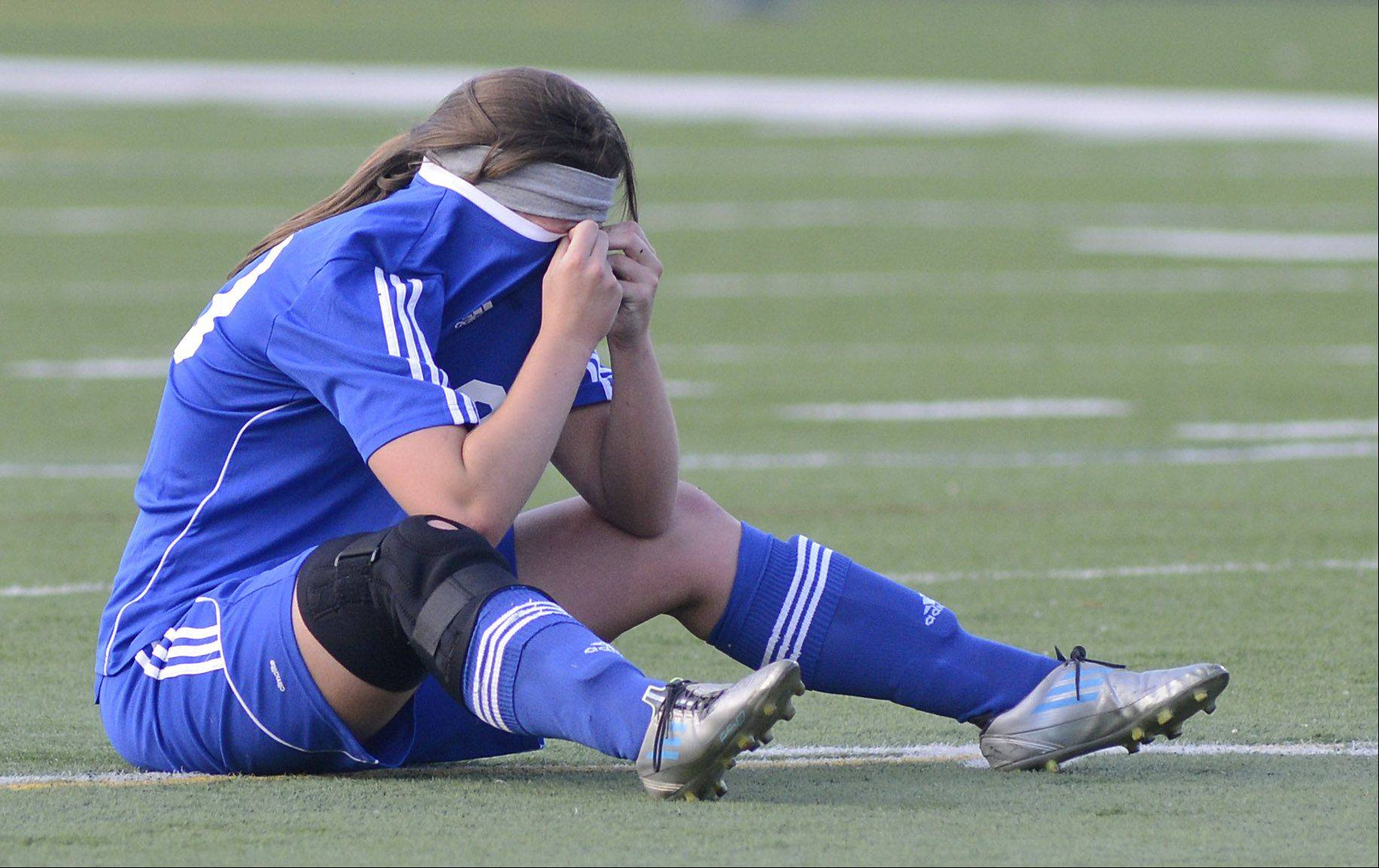 St. Charles North senior Kenzie Rose weeps on the field after the North Stars' Class 3A supersectional loss to Barrington on Wednesday.