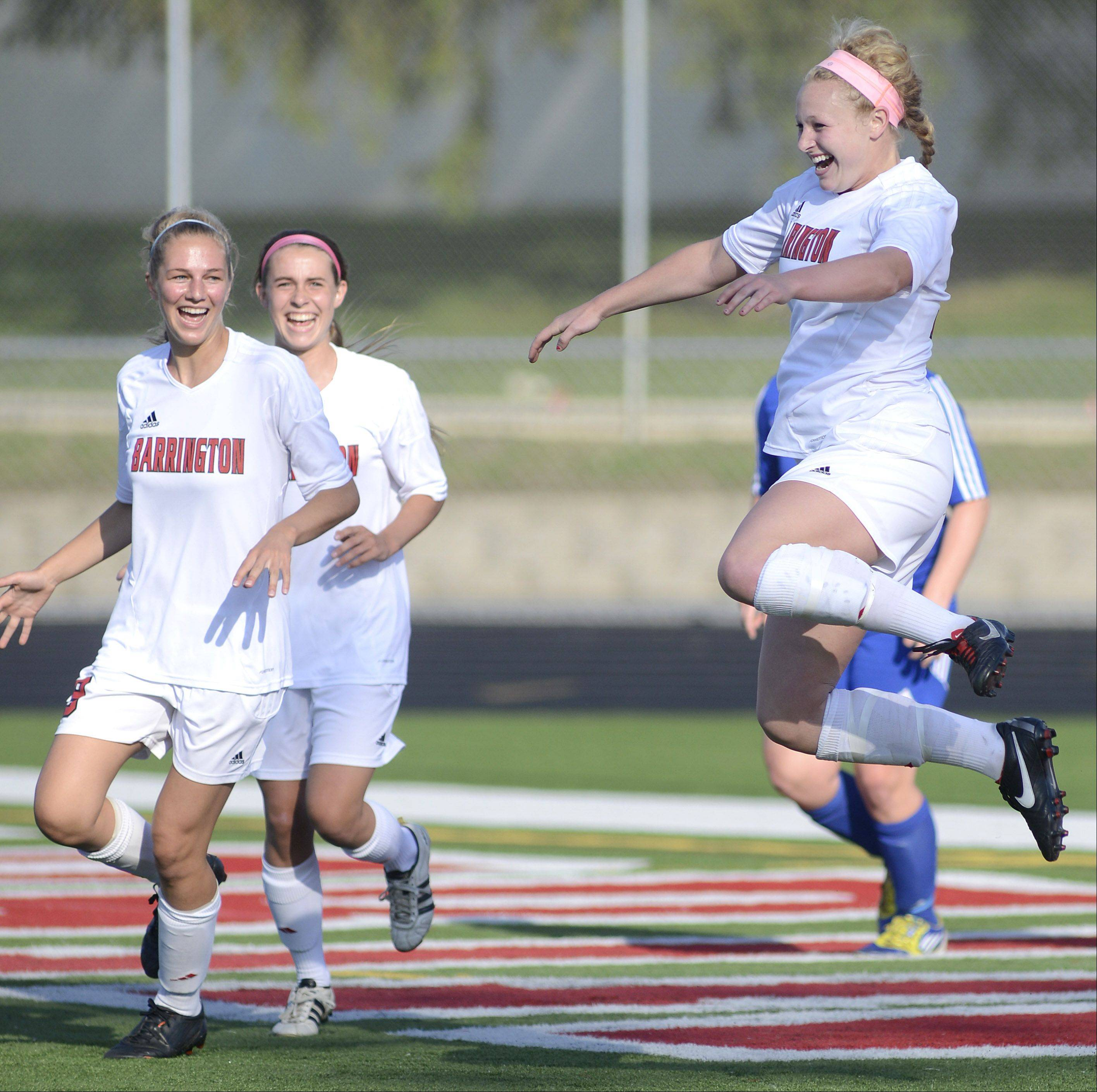 Barrington's Molly Pfeiffer leaps into the air in celebration after scoring a goal minutes into the first half of the Class 3A supersectional in Barrington on Wednesday.