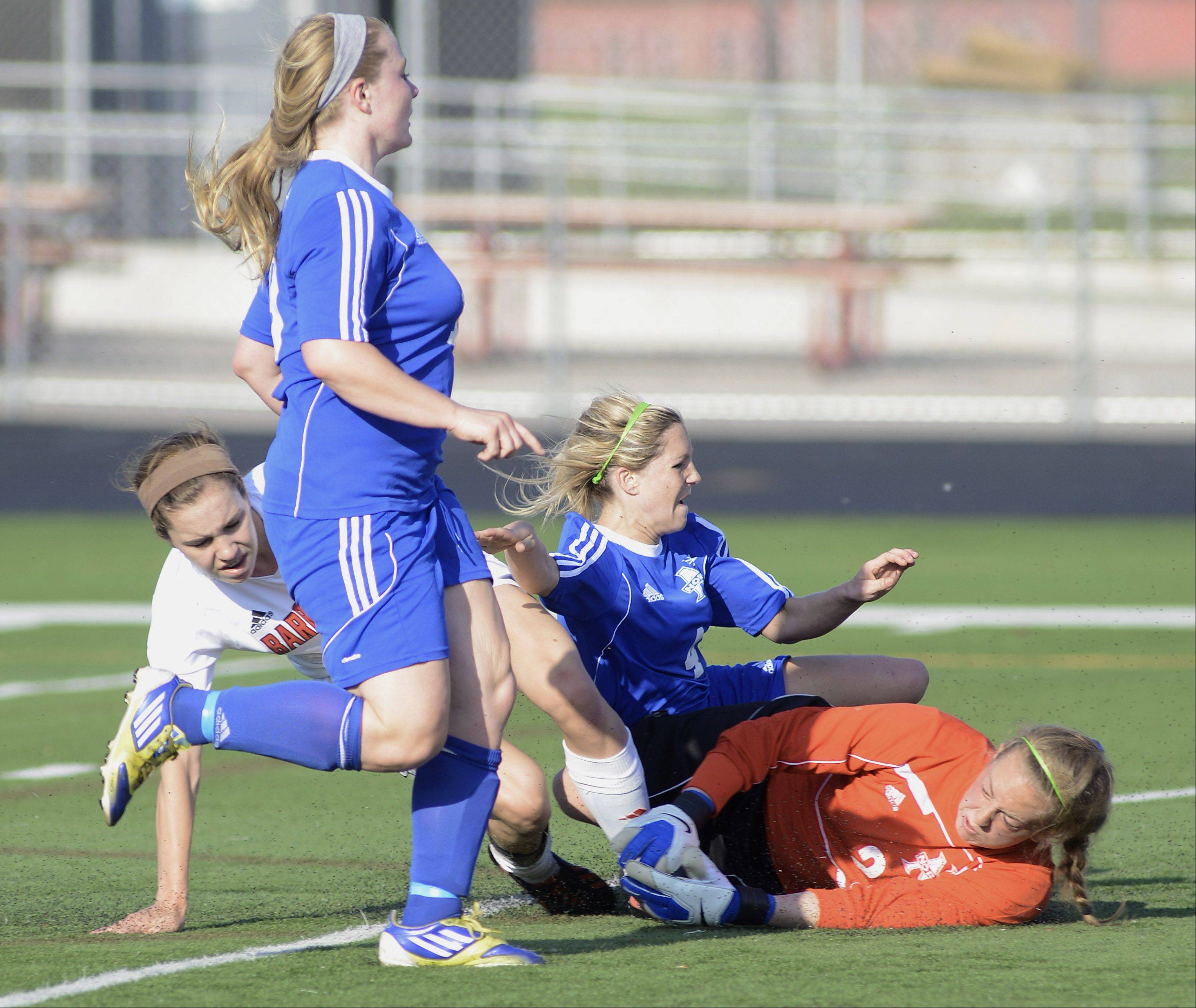 Barrington's Jenna Szczesny collides with St. Charles North goalie Shelby Stitz and Jenny Barr during her drive to the net, resulting in a goal for Barrington in the second half of the Class 3A supersectional on Wednesday. Megan O'Leary is at left.