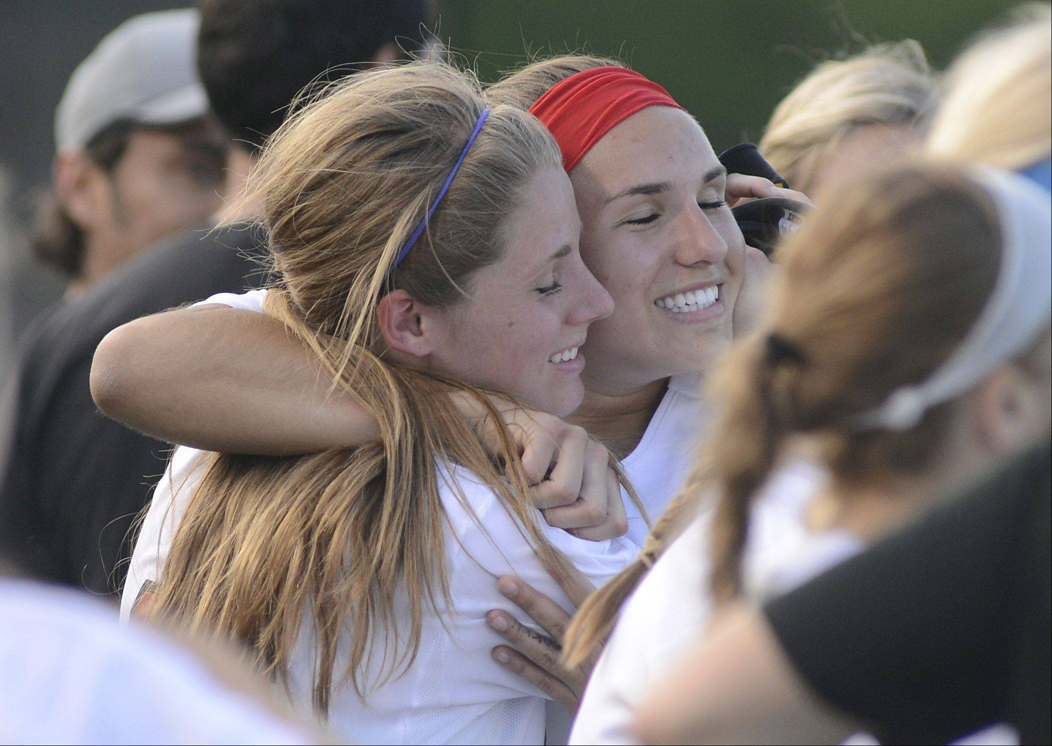 Barrington's Emily Decraene, left, and Elli Ackermann hug on the sidelines in the final seconds of the second half as their Class 3A supersectional comes to fruition in Barrington on Wednesday.