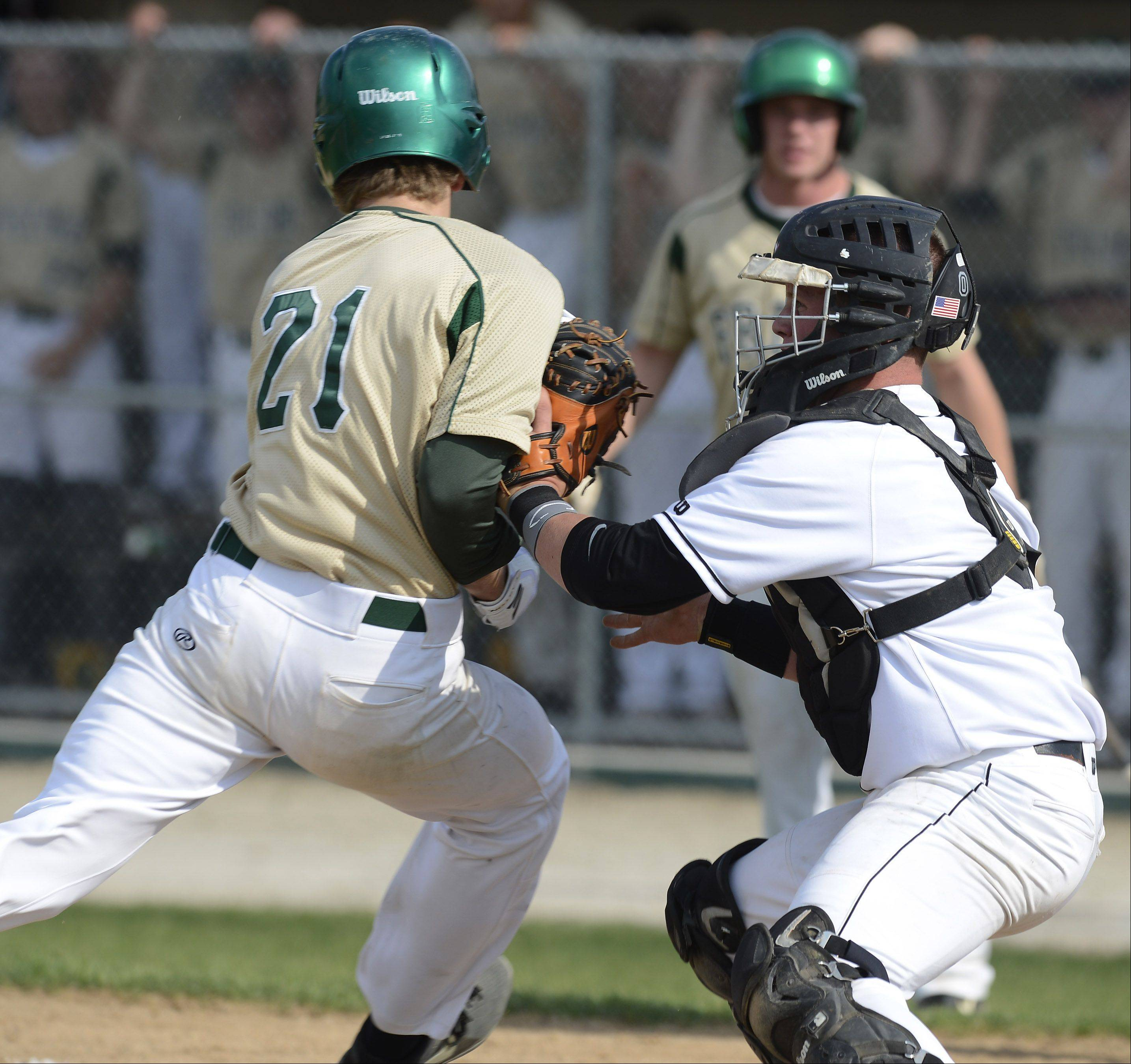 Libertyville catcher Evan Skoug tags out Fremd's Marcus Middlebrook at the plate during the second inning of the Glenbrook North sectional semifinal Wednesday.