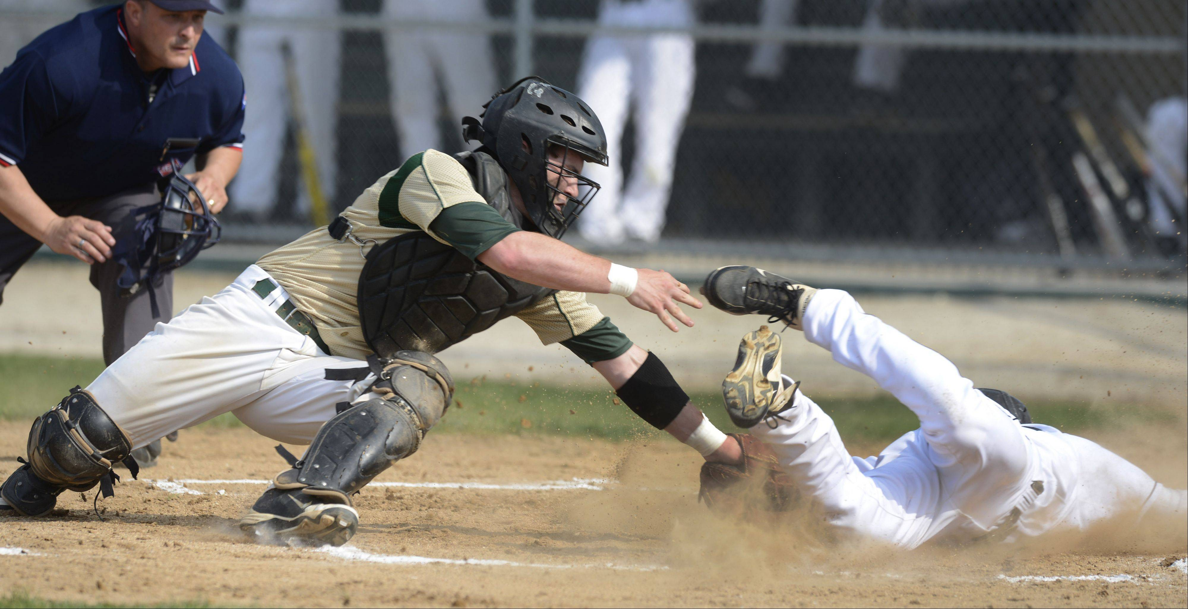 Fremd catcher Alec Dompke applies the late tag to Libertyville's Jimmy Govern, who scores in the bottom of the first inning during the Glenbrook North sectional semifinal Wednesday.