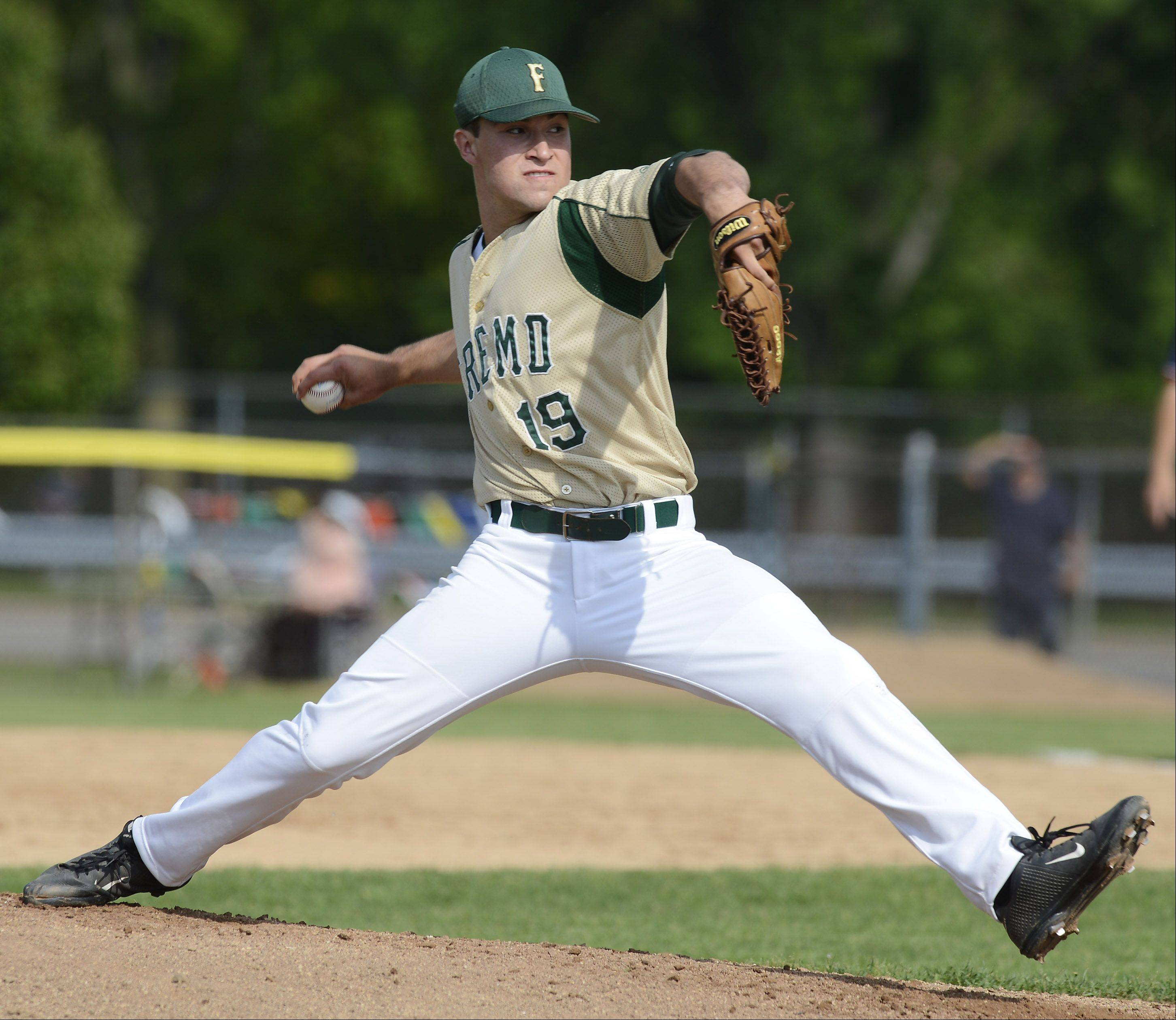 Fremd pitcher Jon Escobar delivers to the plate during the Glenbrook North sectional semifinal against Libertyville on Wednesday.