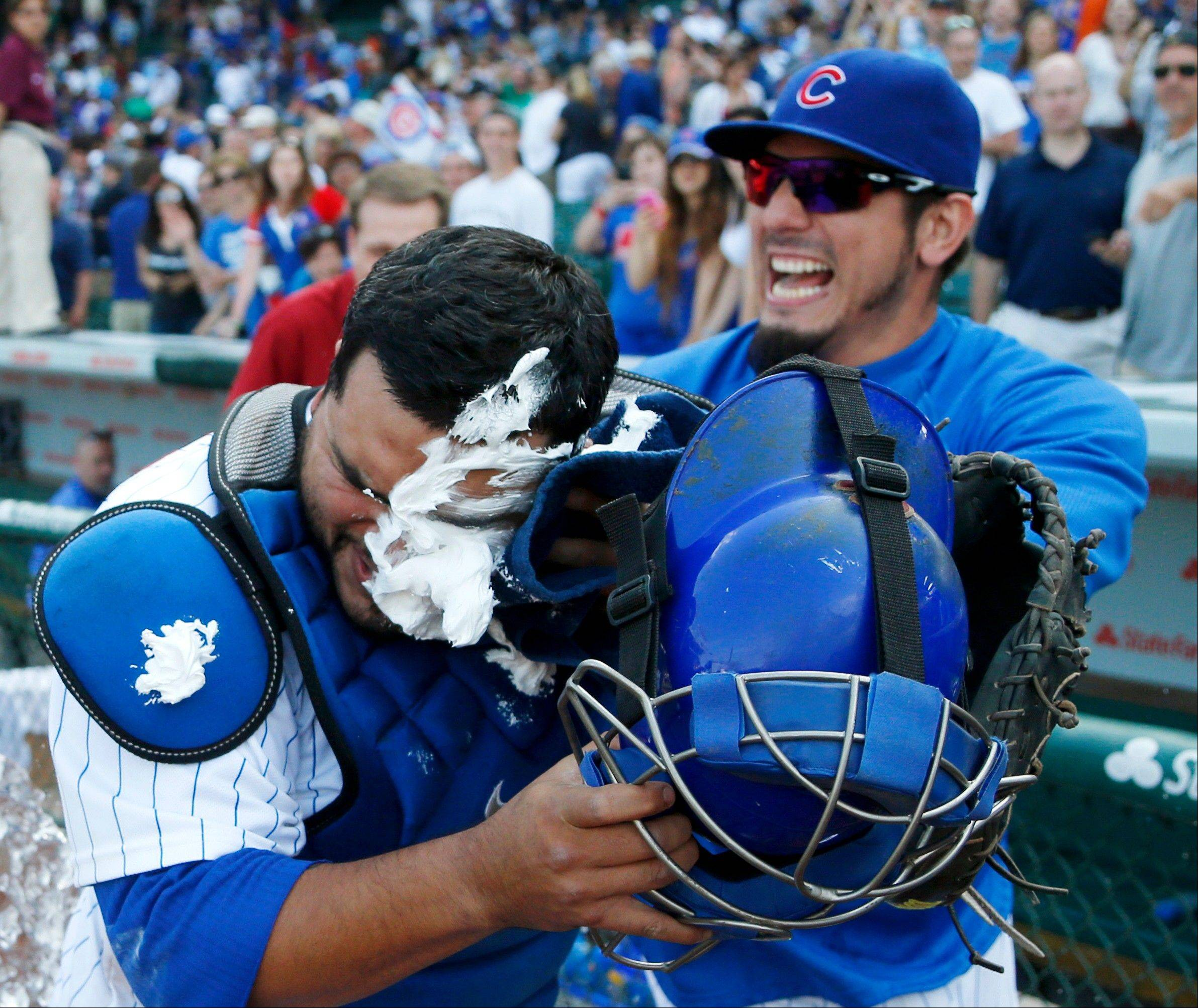 Matt Garza delivers a shaving cream pie to the face of catcher Dioner Navarro, who hit 3 home runs in the Cubs' 9-3 win over the White Sox at Wrigley Field on Wednesday.