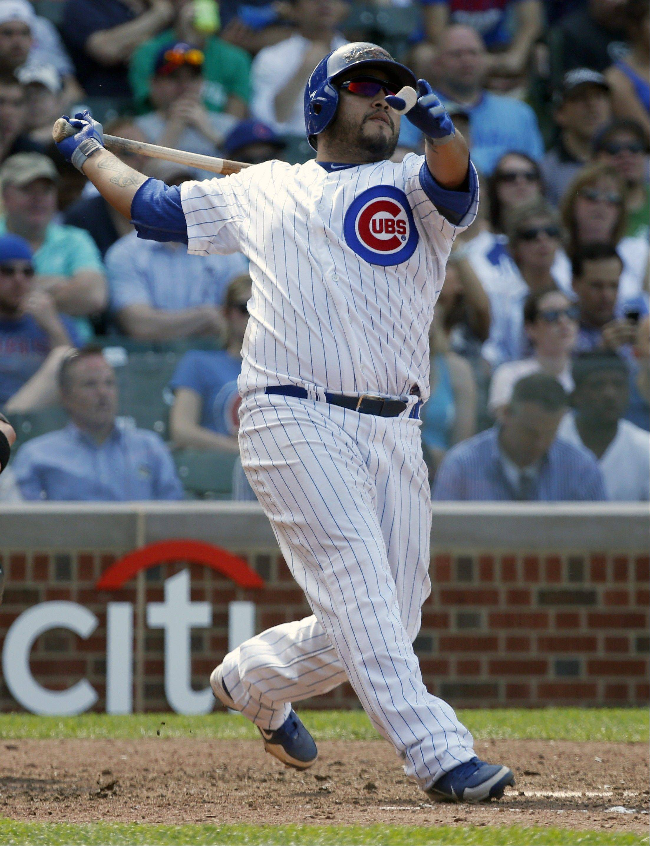 Dioner Navarro admires his third homer of the game Wednesday, in the sixth inning of the Cubs' 9-3 win over the White Sox at Wrigley Field.