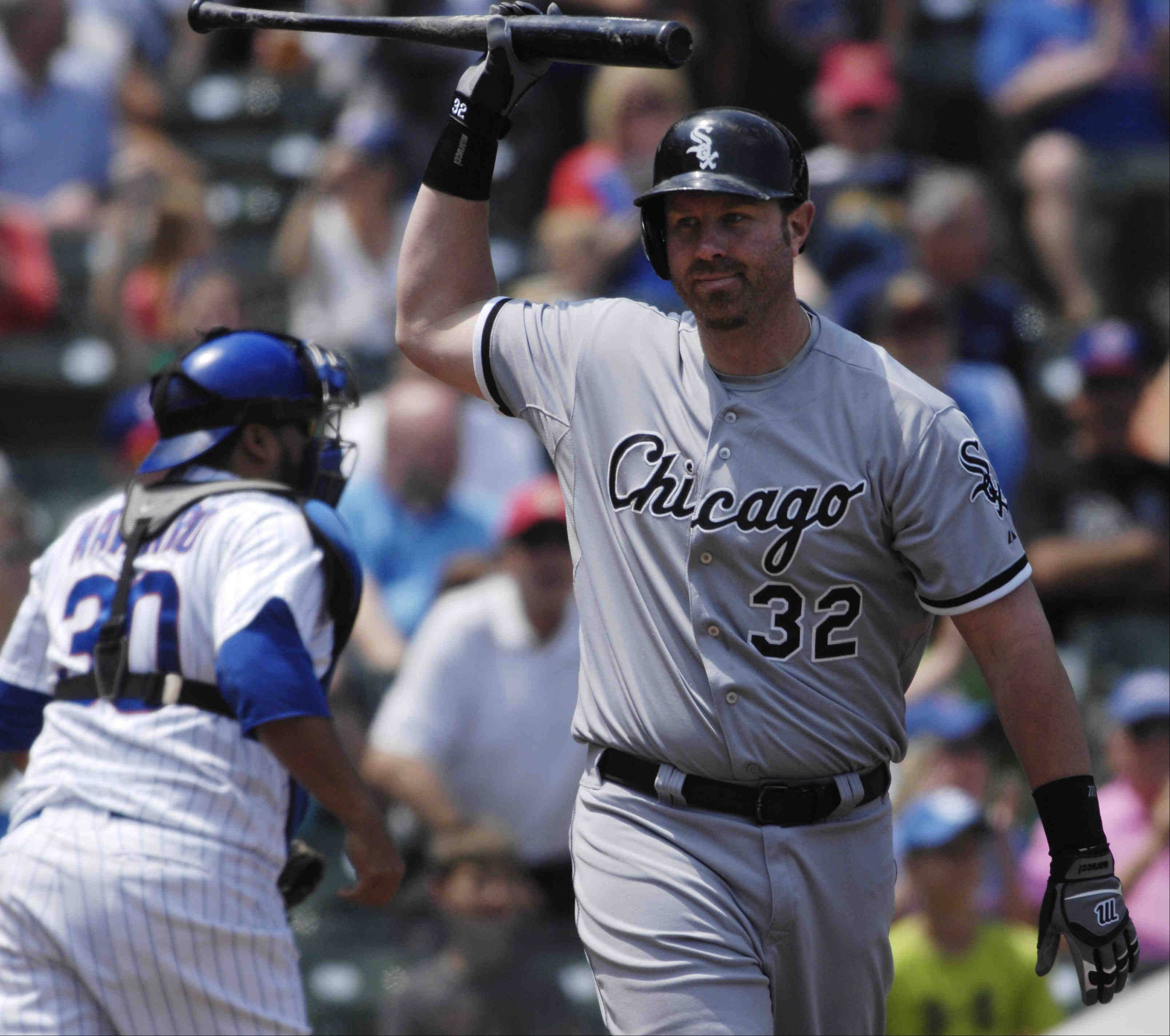 Chicago White Sox first baseman Adam Dunn throws his bat after striking out in the first inning.