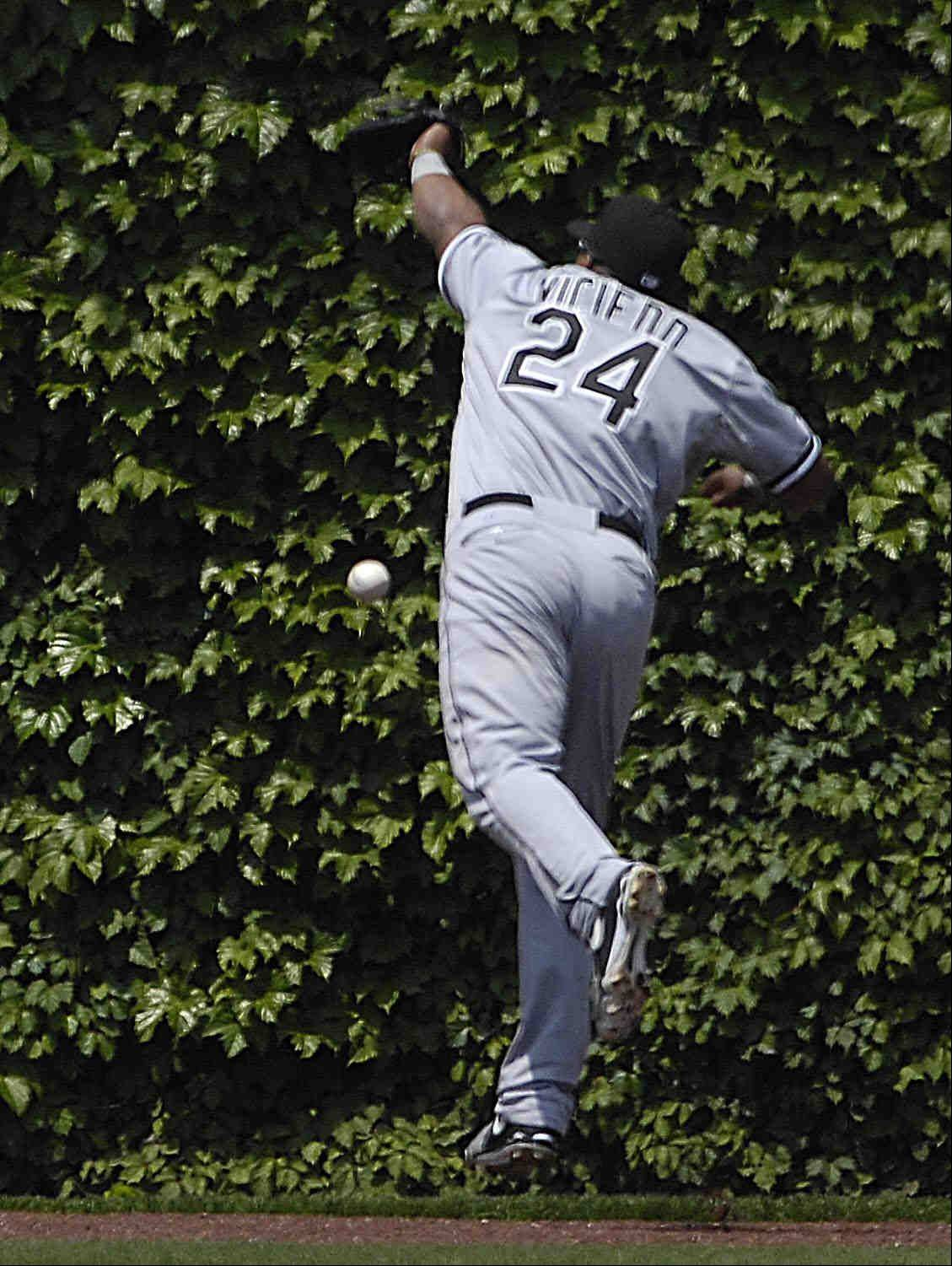 Chicago White Sox left fielder Dayan Viciedo missed a fly ball by Chicago Cubs leadoff hitter David DeJesus in the first inning.