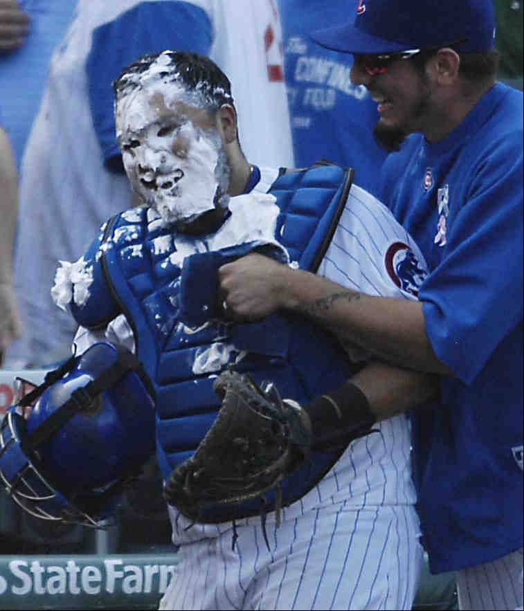 Chicago Cubs starting pitcher Matt Garza hugs catcher Dioner Navarro after smashing shaving cream in his face following the game.