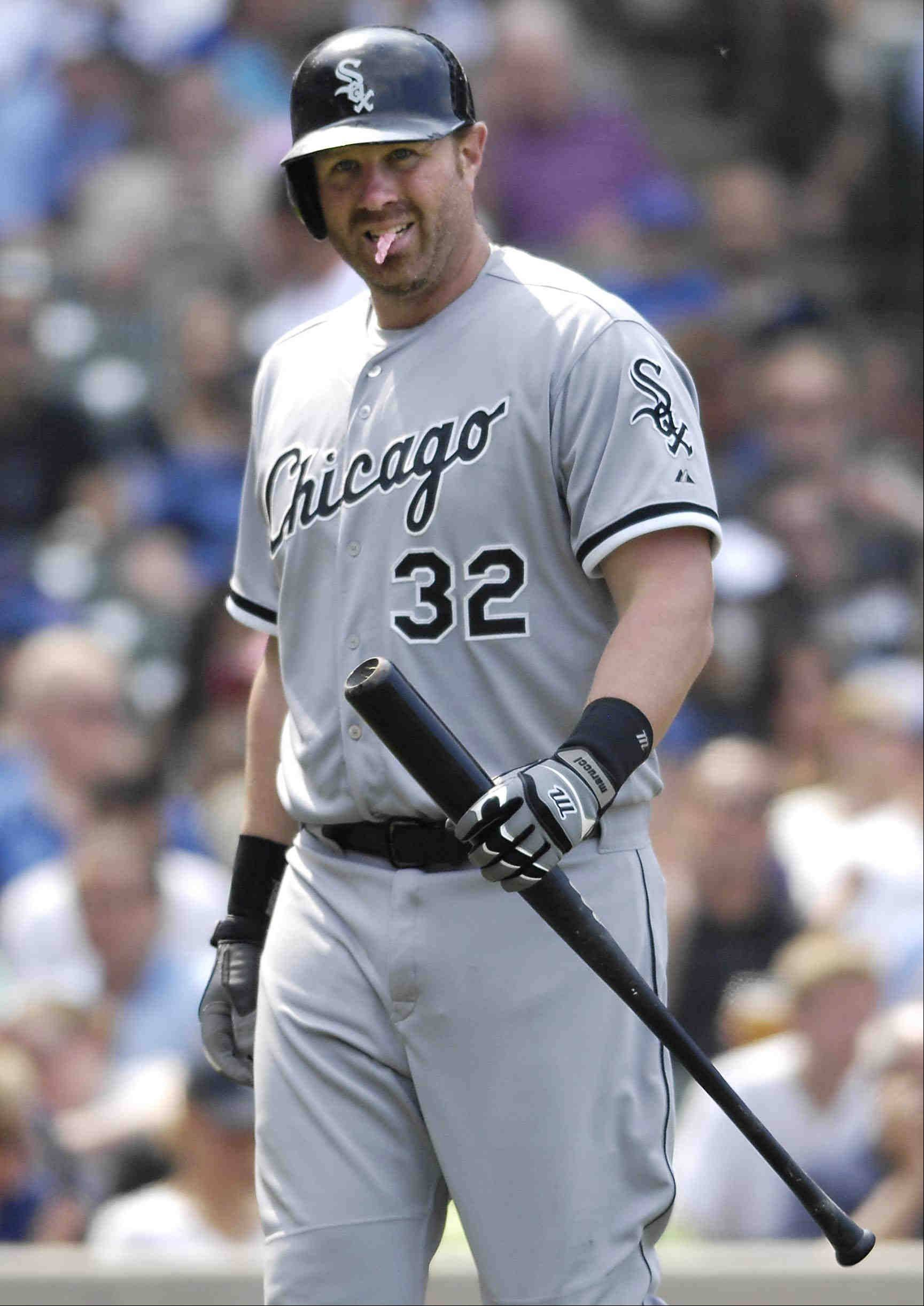 Chicago White Sox first baseman Adam Dunn walks back to the dugout after striking out for the third time on the day.