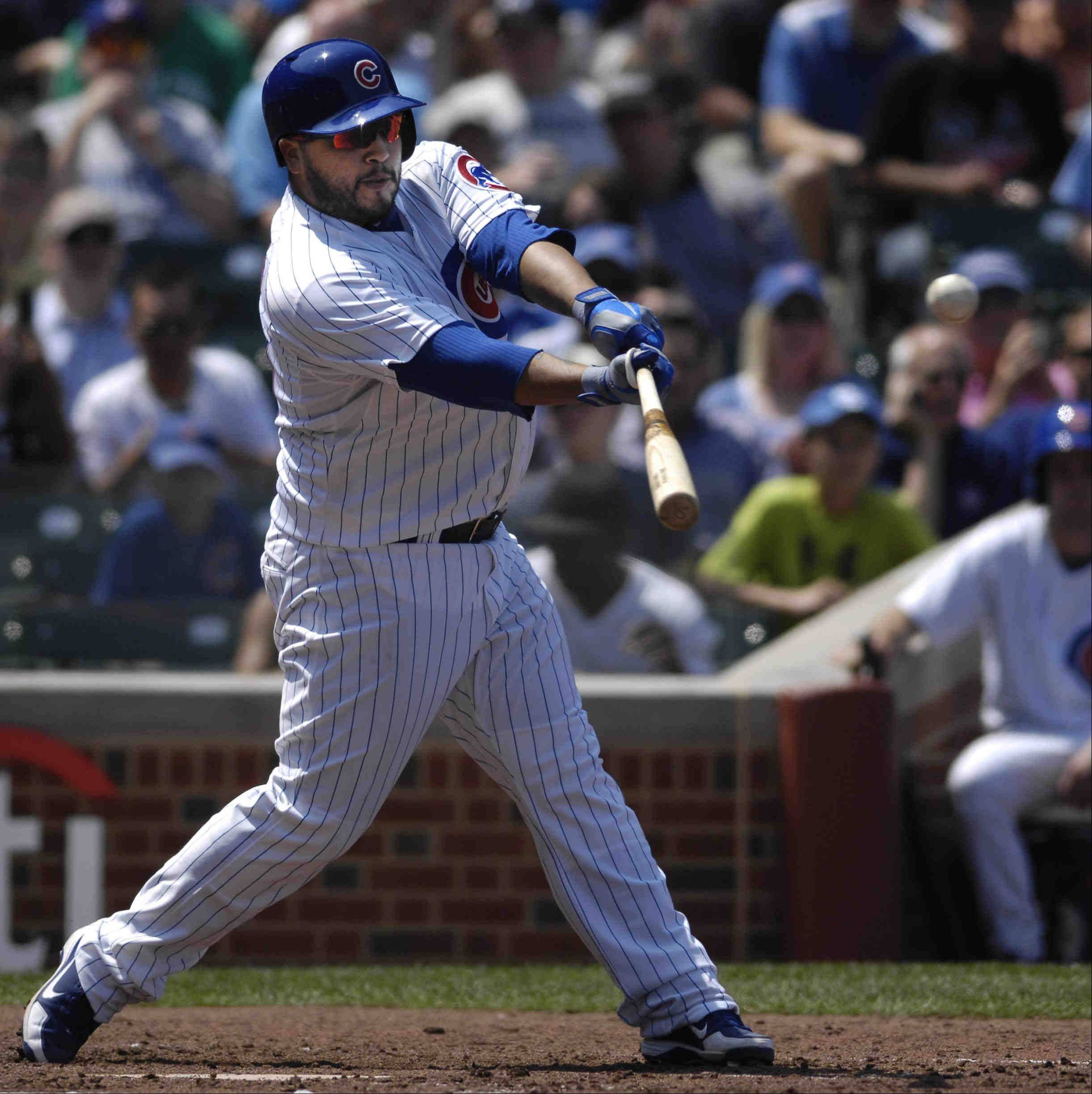 Chicago Cubs catcher Dioner Navarro hits a home run in the second inning.