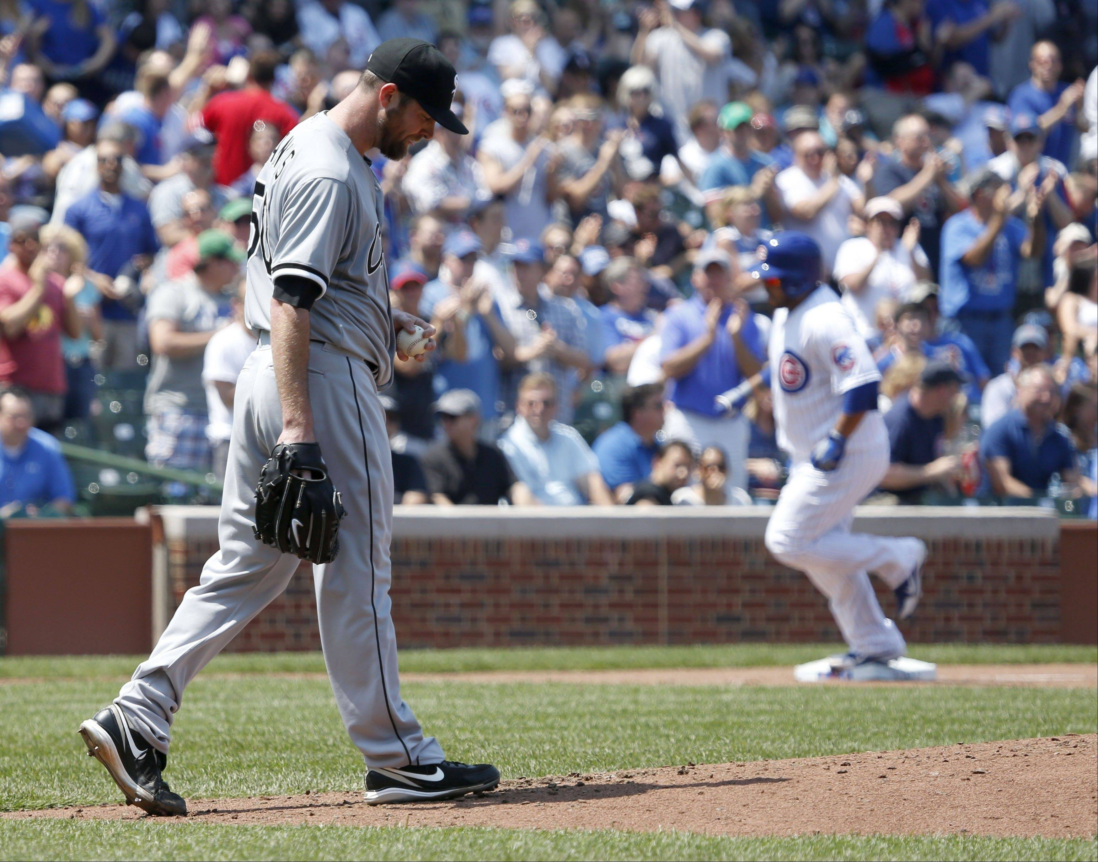 Associated PressWhite Sox starter John Danks gave up a pair of homers to Dioner Navarro, right, during 4 innings of work Wednesday in the Cubs' 9-3 victory at Wrigley Field.