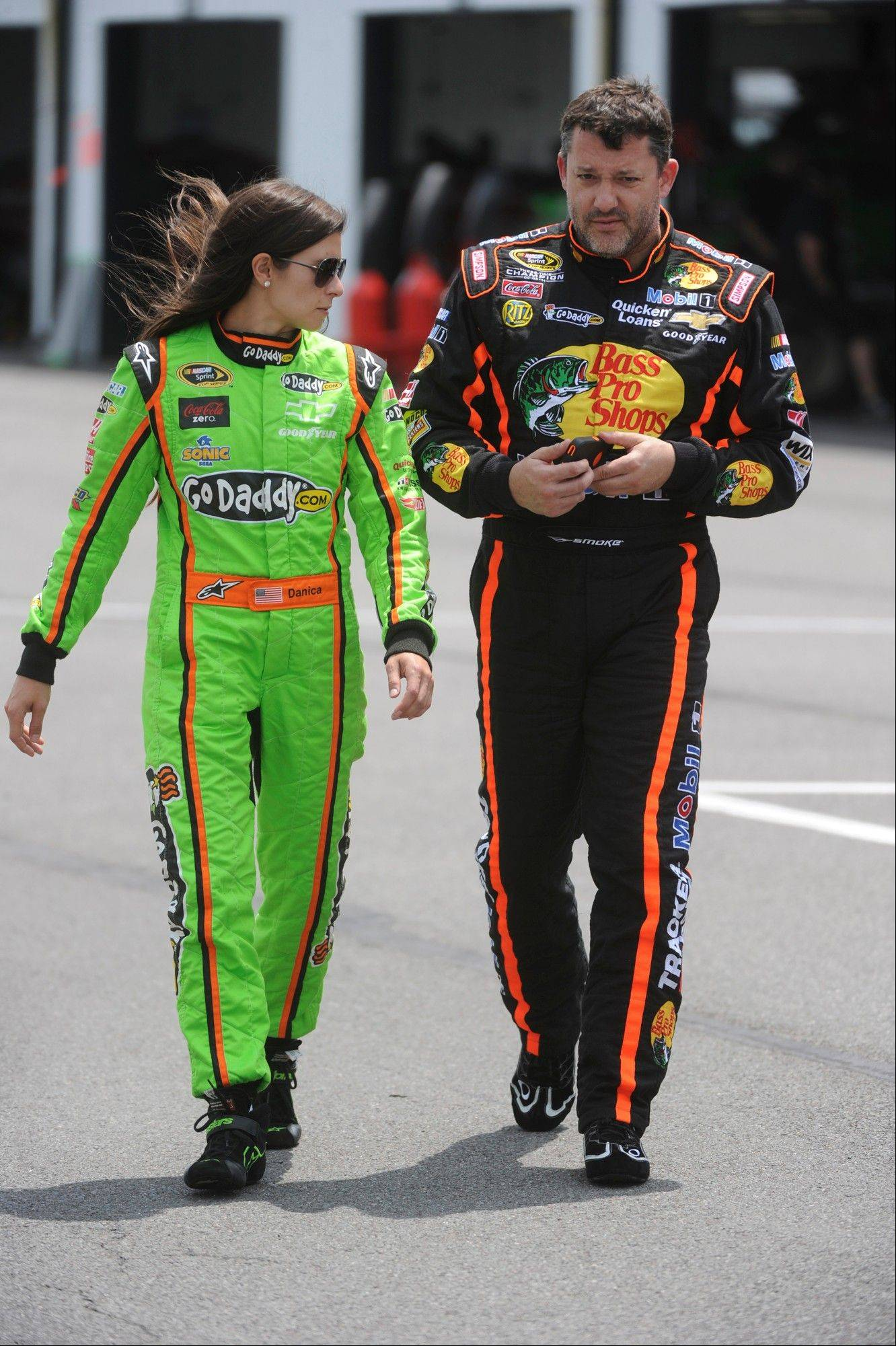 NASCAR drivers Danica Patrick, left, and Tony Stewart leave the garages at Pocono Raceway in Long Pond, Pa., after tire testing at the track on Wednesday, May 29, 2013.