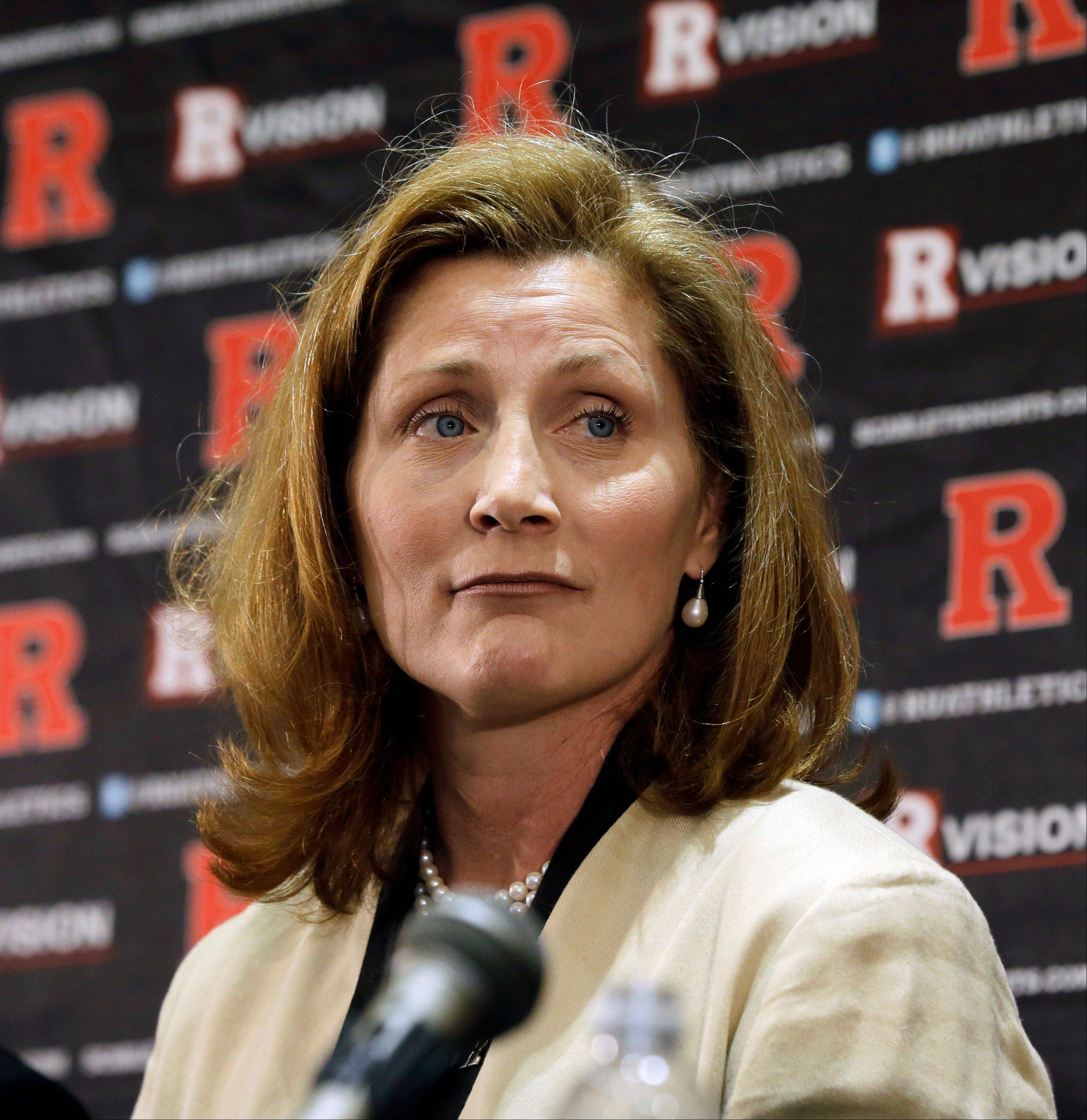 FILE - In this Wednesday, May 15, 2013 file photo, Julie Hermann listens during a news conference where she was introduced as the new athletic director at Rutgers University, in Piscataway, N.J. Hermann, hired to clean up Rutgers' scandal-scarred athletic program, quit as Tennessee's women's volleyball coach 16 years ago after her players submitted a letter complaining she ruled through humiliation, fear and emotional abuse, The Star-Ledger reported Saturday, May 25, 2013, on its website.