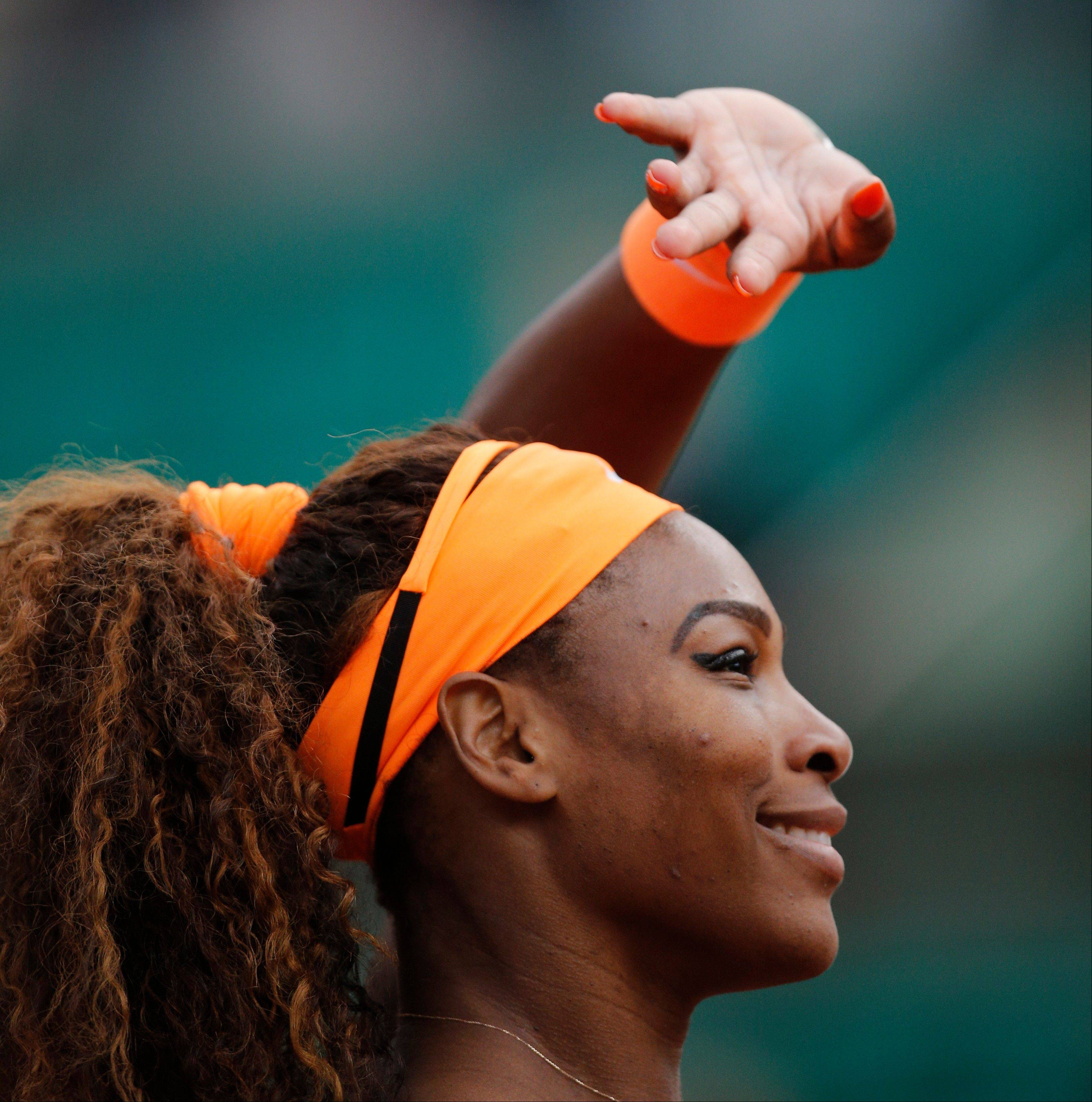 Serena Williams of the U.S. greets spectators after defeating Caroline Garcia of France in their second round match of the French Open tennis tournament, at Roland Garros stadium in Paris, Wednesday, May 29, 2013. Williams won in two sets 6-1, 6-2.