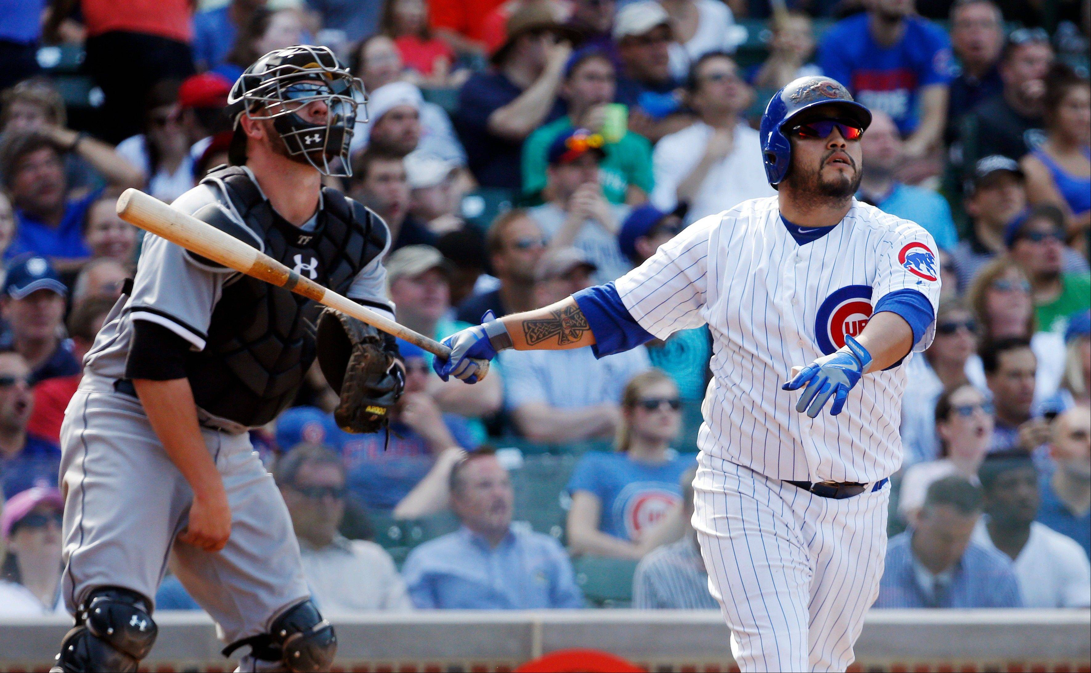 Chicago Cubs' Dioner Navarro, right, watches his three-run home run along with Chicago White Sox catcher Tyler Flowers during the seventh inning of a interleague baseball game Wednesday, May 29, 2013, in Chicago. It was Navarro's third home run of the game.