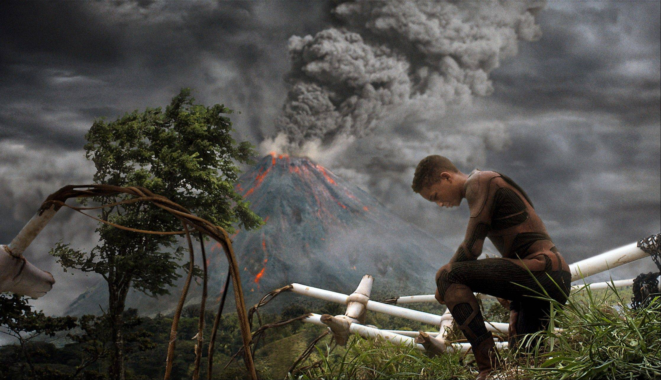 "A would-be space ranger (Jaden Smith) takes a knee to contemplate how he can save himself and his injured father in M. Night Shyamalan's ""After Earth."""