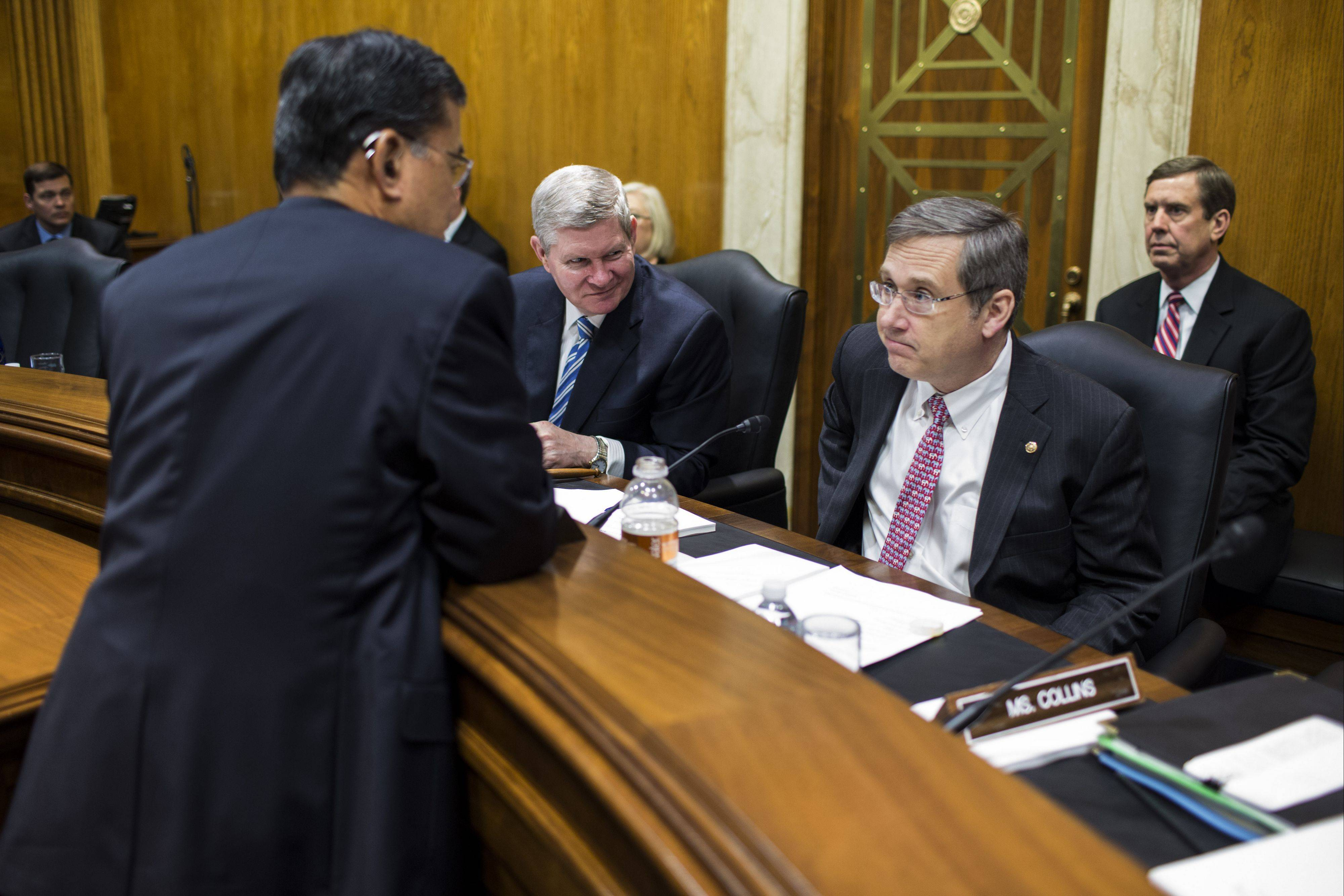 U.S. Sen. Mark Kirk, a Highland Park Republican at right, and colleague Tim Johnson, a South Dakota Democrat, center, speak with Secretary of Veterans Affairs Eric Shinseki after a Military Construction, Veteran Affairs, and Related Agencies Subcommittee hearing in Washington, D.C. Both Kirk and Johnson returned to the Senate after having strokes.