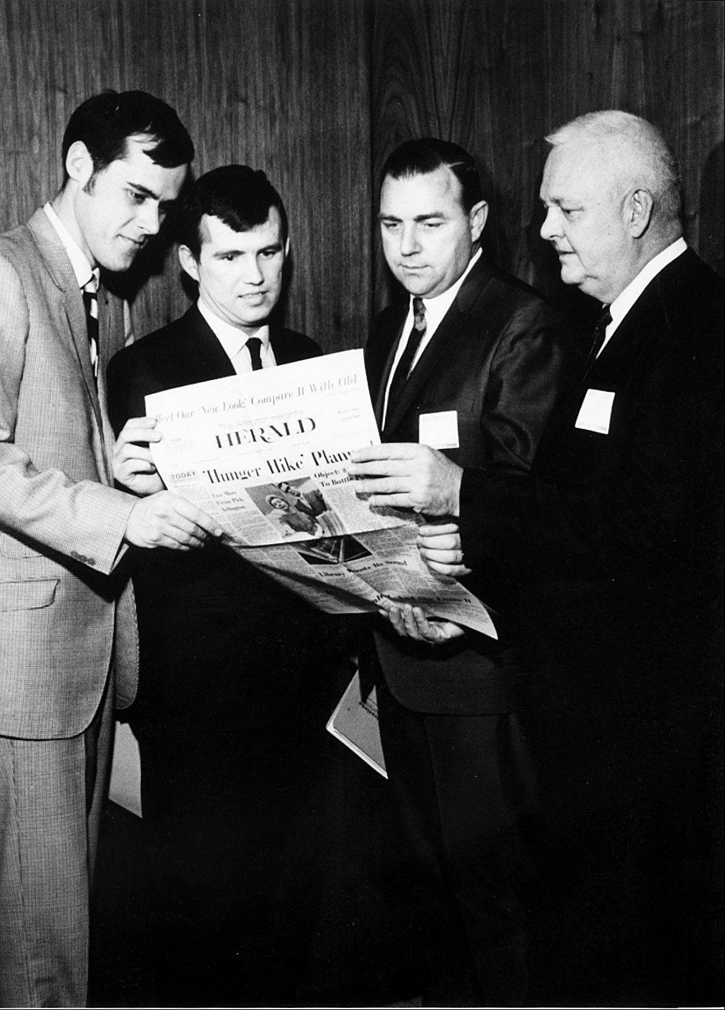 Rolling Meadows Mayor Roland Meyer, second from right, looks at a copy of The Herald in 1969, with, from left, City Manager Gary Machunze, Herald Editor Edward Murnane and Publisher Stuart R. Paddock Jr., far right.