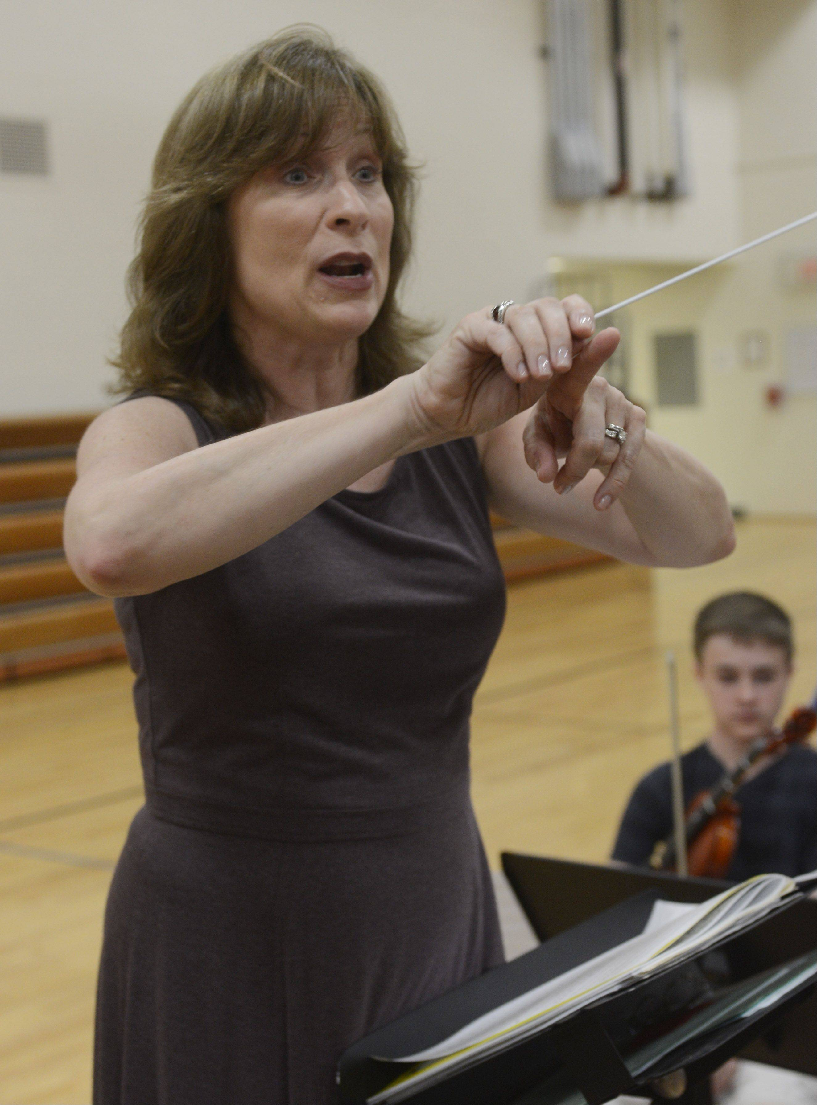 Susan Blaese rehearses the combined orchestra Thursday morning.