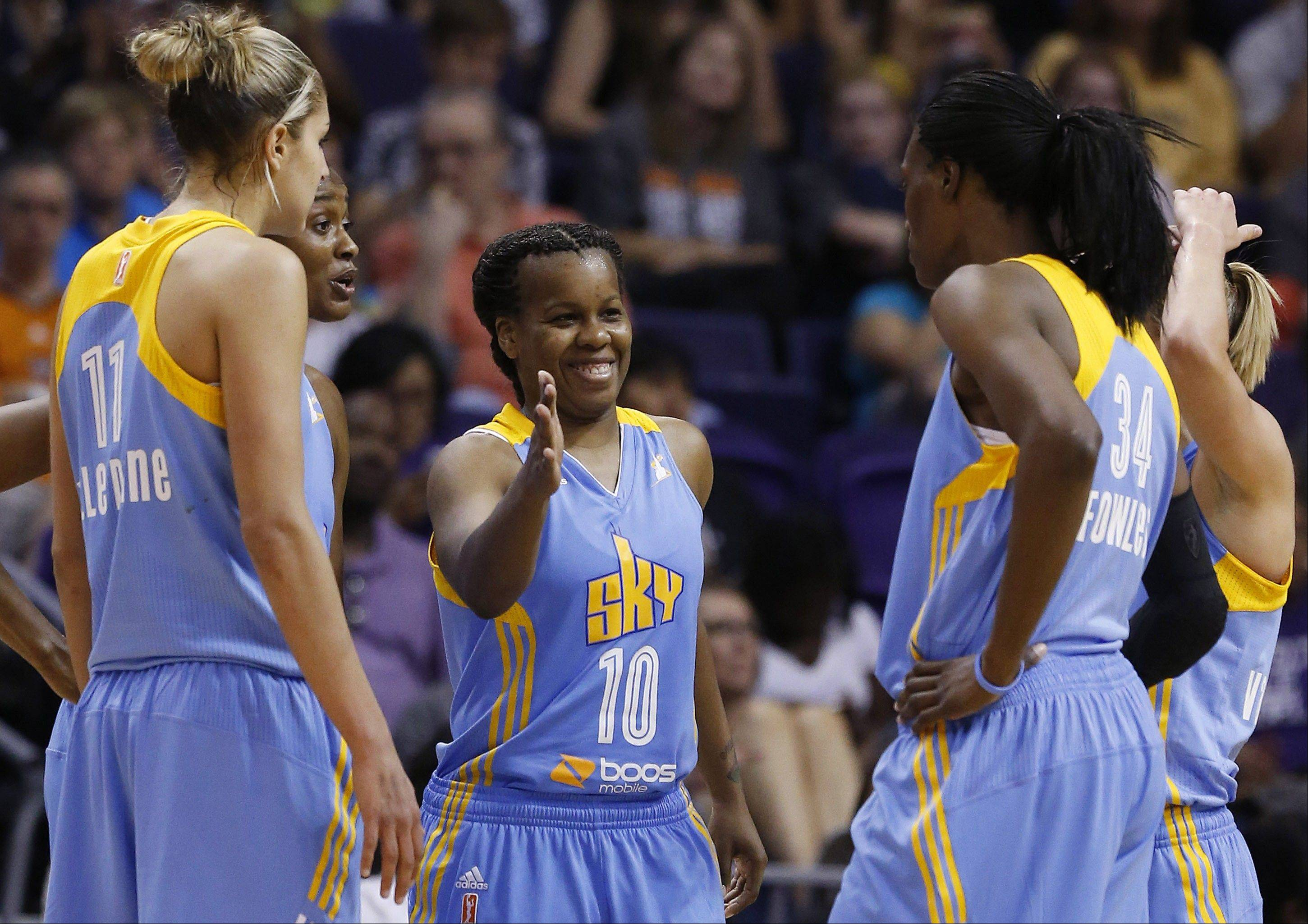 Chicago Sky's Epiphanny Prince (10) smiles as she celebrates a win over the Phoenix Mercury with rookie Elena Delle Donne (11) and veteran Sylvia Fowles (34). The Sky defeated the Mercury and rookie center Brittney Griner 102-80.