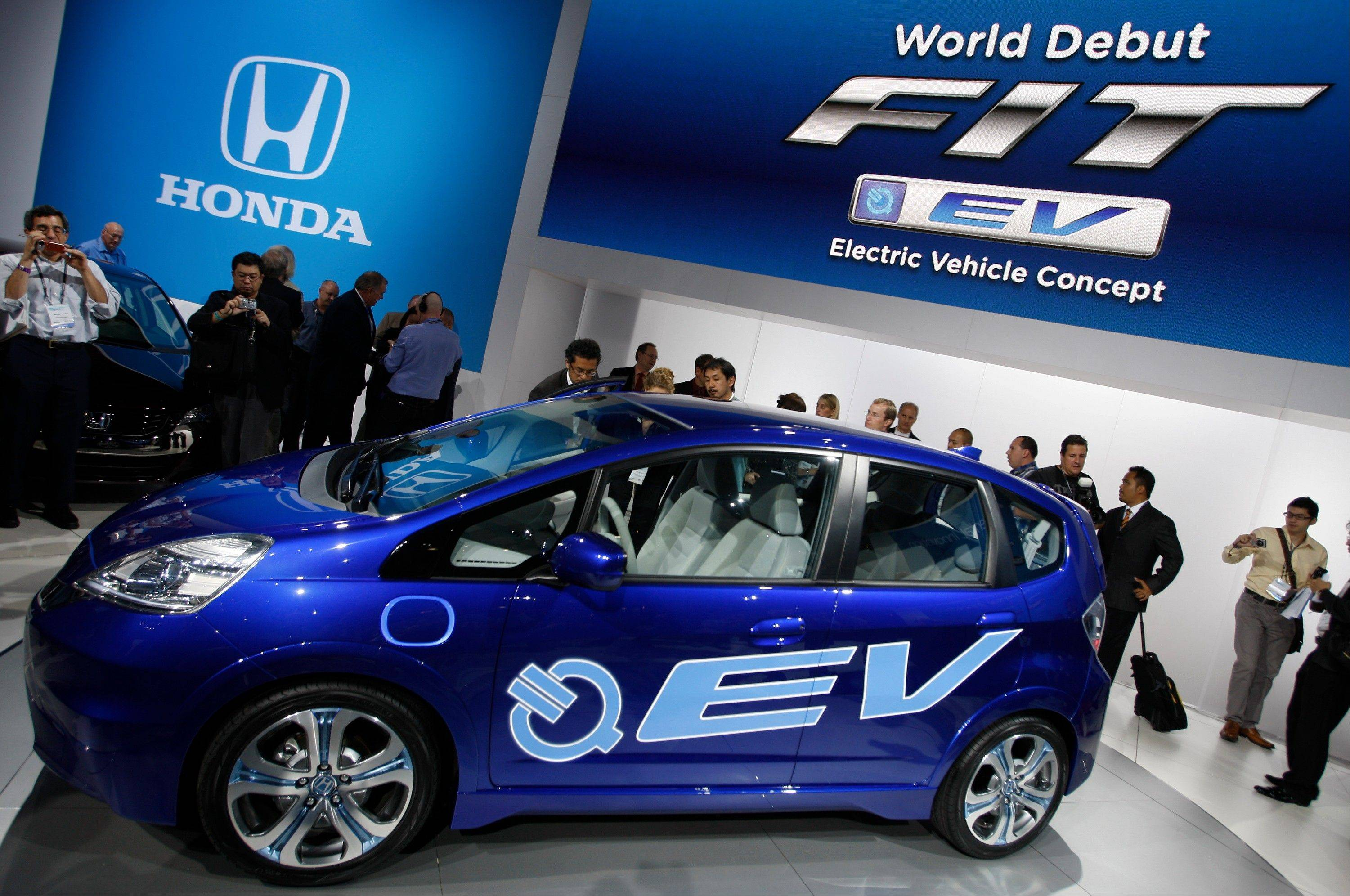 Honda introduces its FIT EV Electric Vehicle Concept car at the Los Angeles auto show in November 2010. Auto companies in the U.S. are lowering lease prices for electric cars as they try to jump-start slow sales in a competitive market.