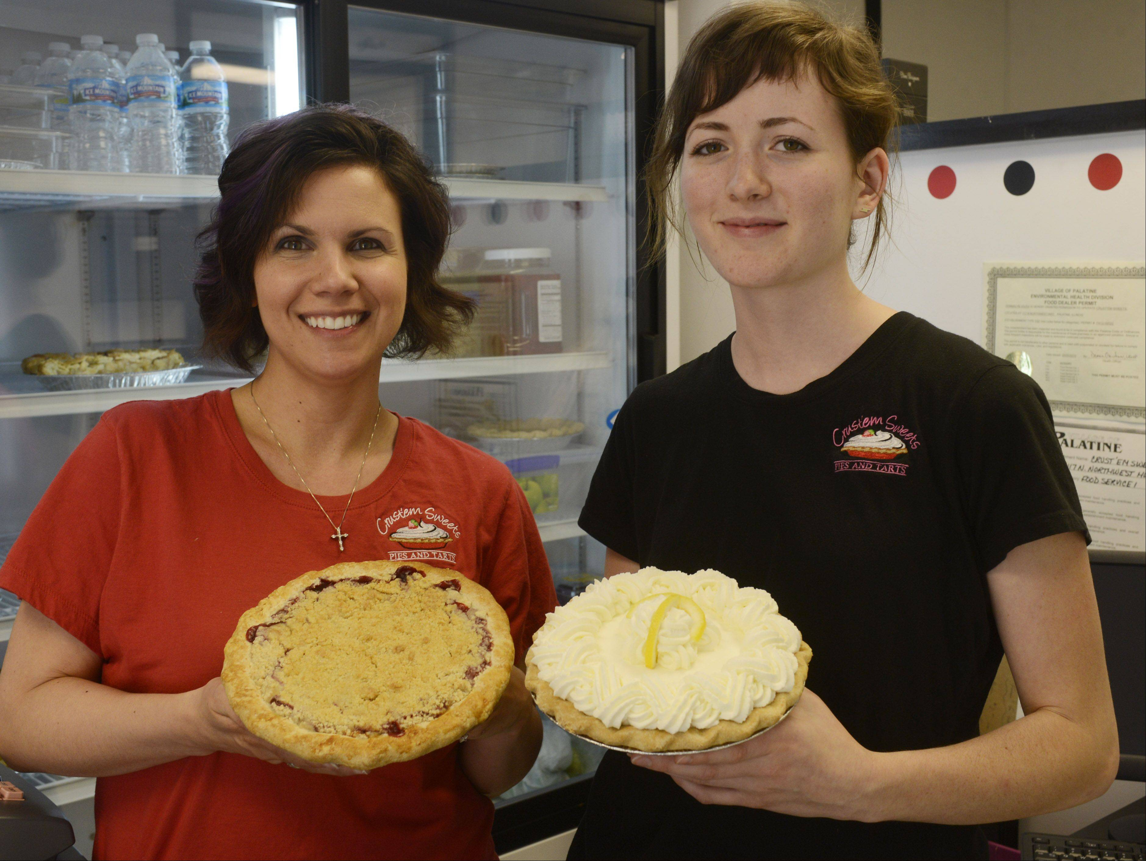 Owner/baker Donnalyn Vojta, left, and baker Amanda Martensen hold pies at Crust'em Sweets in Palatine.