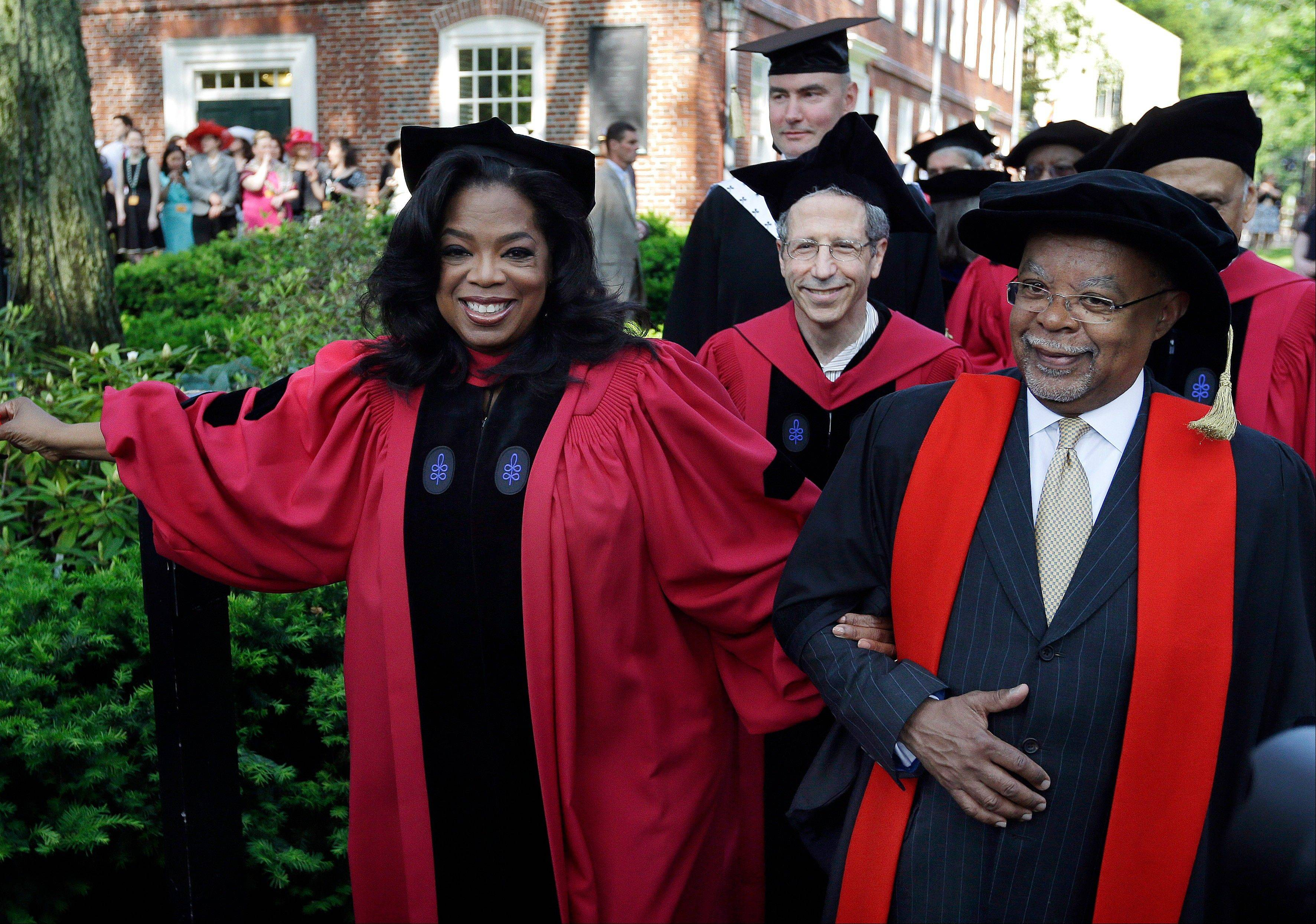 Oprah Winfrey walks with Professor Henry Louis Gates in the procession during commencement ceremonies Thursday at Harvard University in Cambridge, Mass..