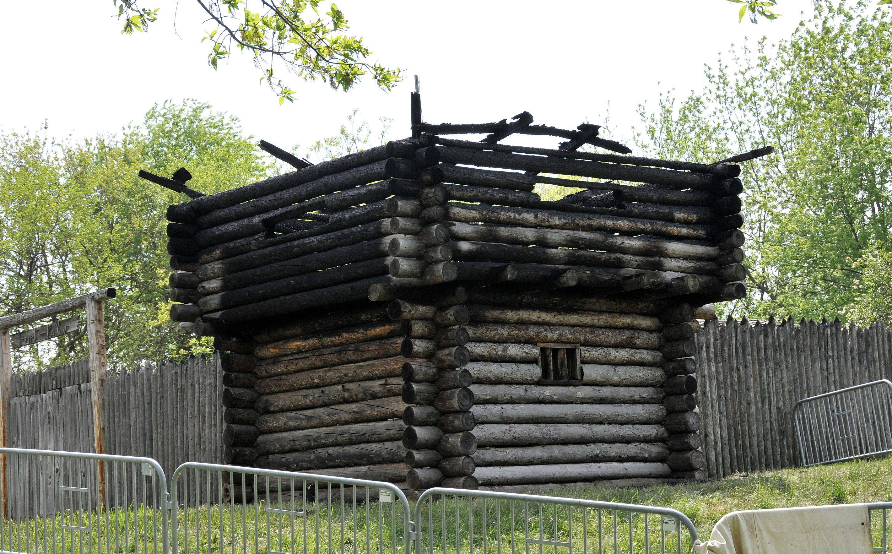 The fire-damaged blockhouse at Naper Settlement's Fort Payne will likely be demolished and replaced with stockade fencing. Naper Settlement officials are unsure if and when it would be replaced.