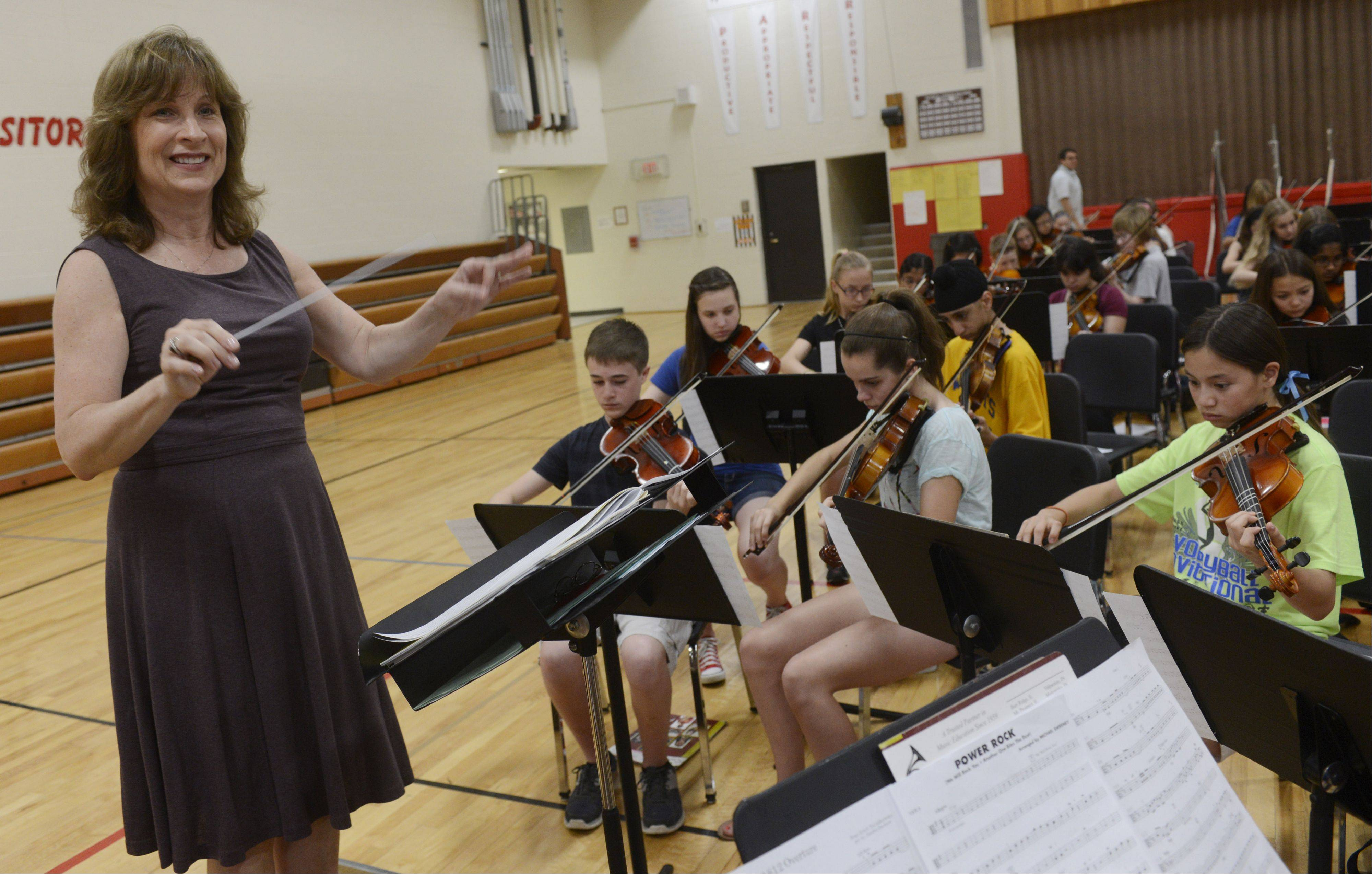 Susan Blaese directs the orchestra in a rehearsal of the 1812 Overture.