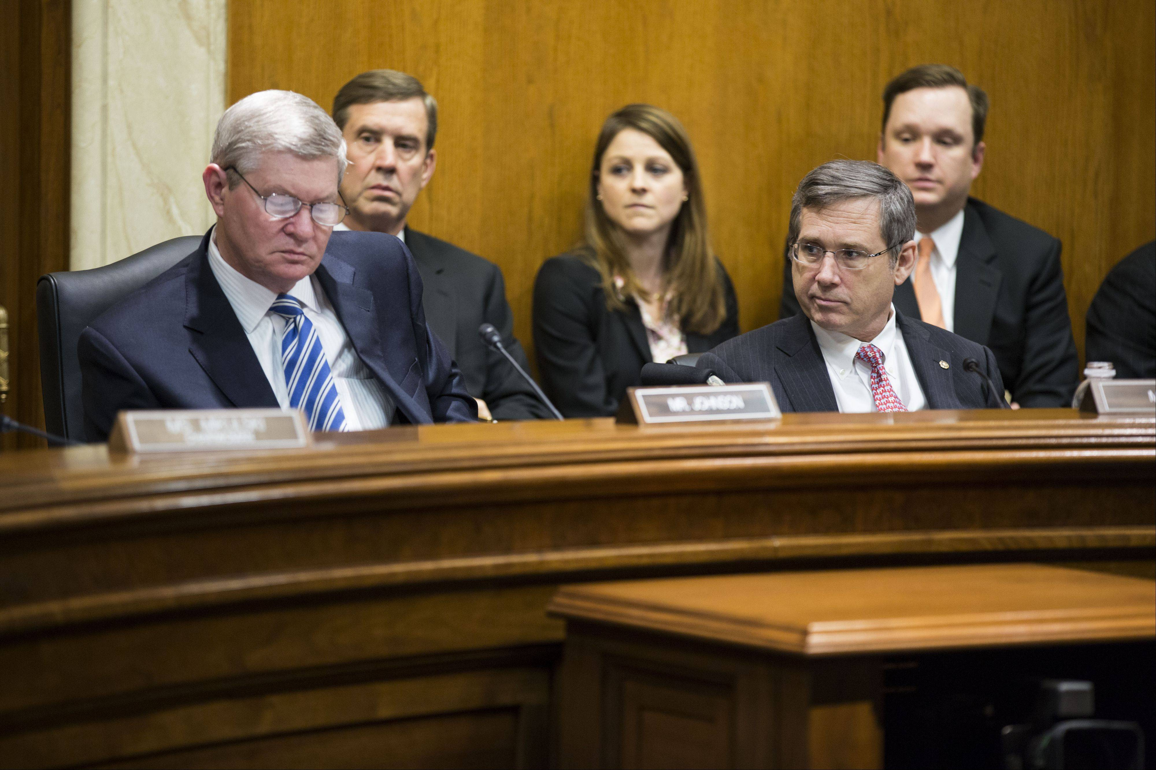 U.S. senators Mark Kirk, a Highland Park Republican at front right, and Tim Johnson, a South Dakota Democrat at left, attend a Military Construction, Veteran Affairs, and Related Agencies Subcommittee hearing in Washington, D.C. Both Senators returned to Congress after suffering strokes.
