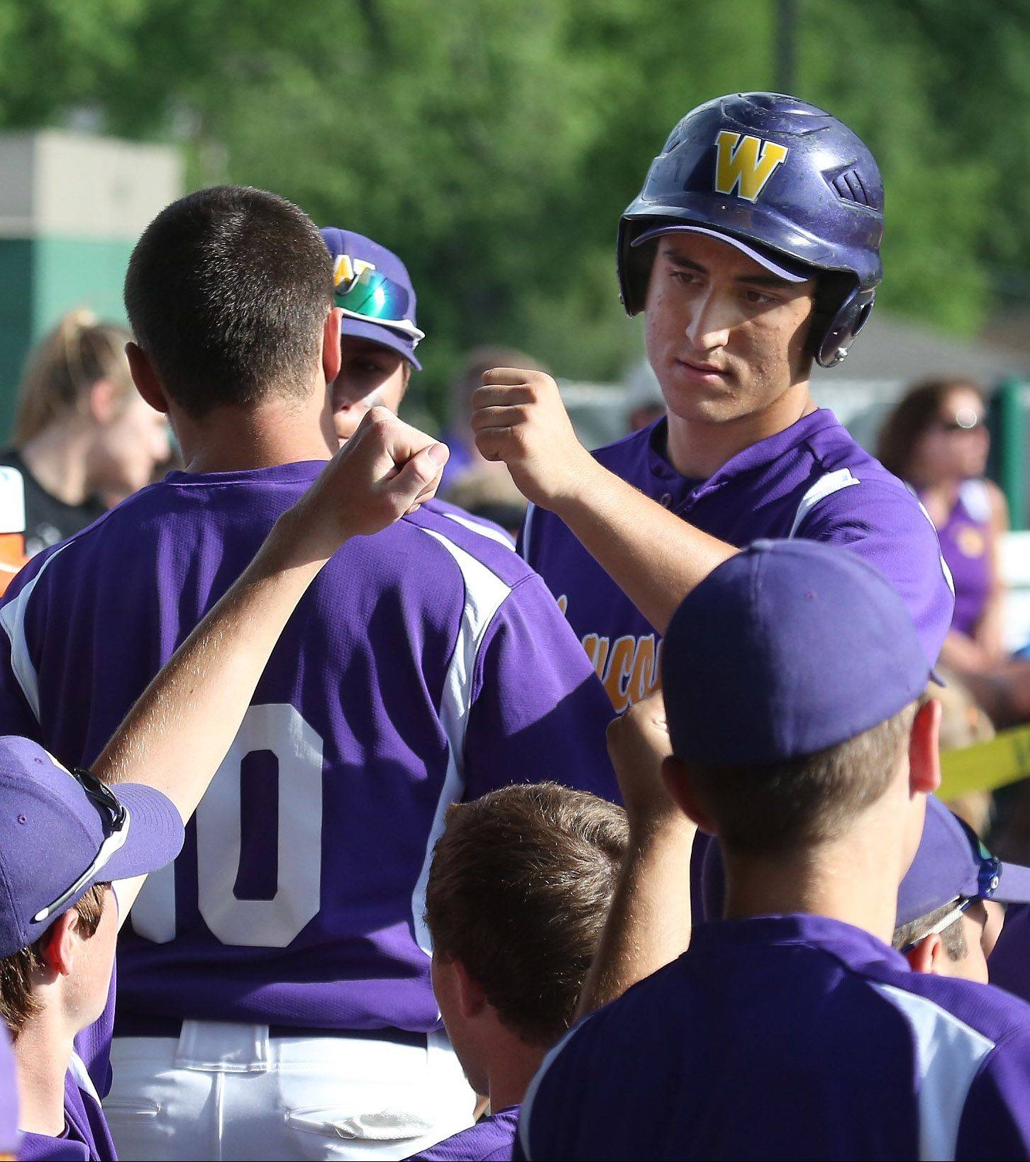 Wauconda's Joe Lovelle is congratulated by teammates after scoring the first run in Class 3A sectional semifinal play Thursday against Richmond-Burton at Grayslake Central. Wauconda won 9-1.
