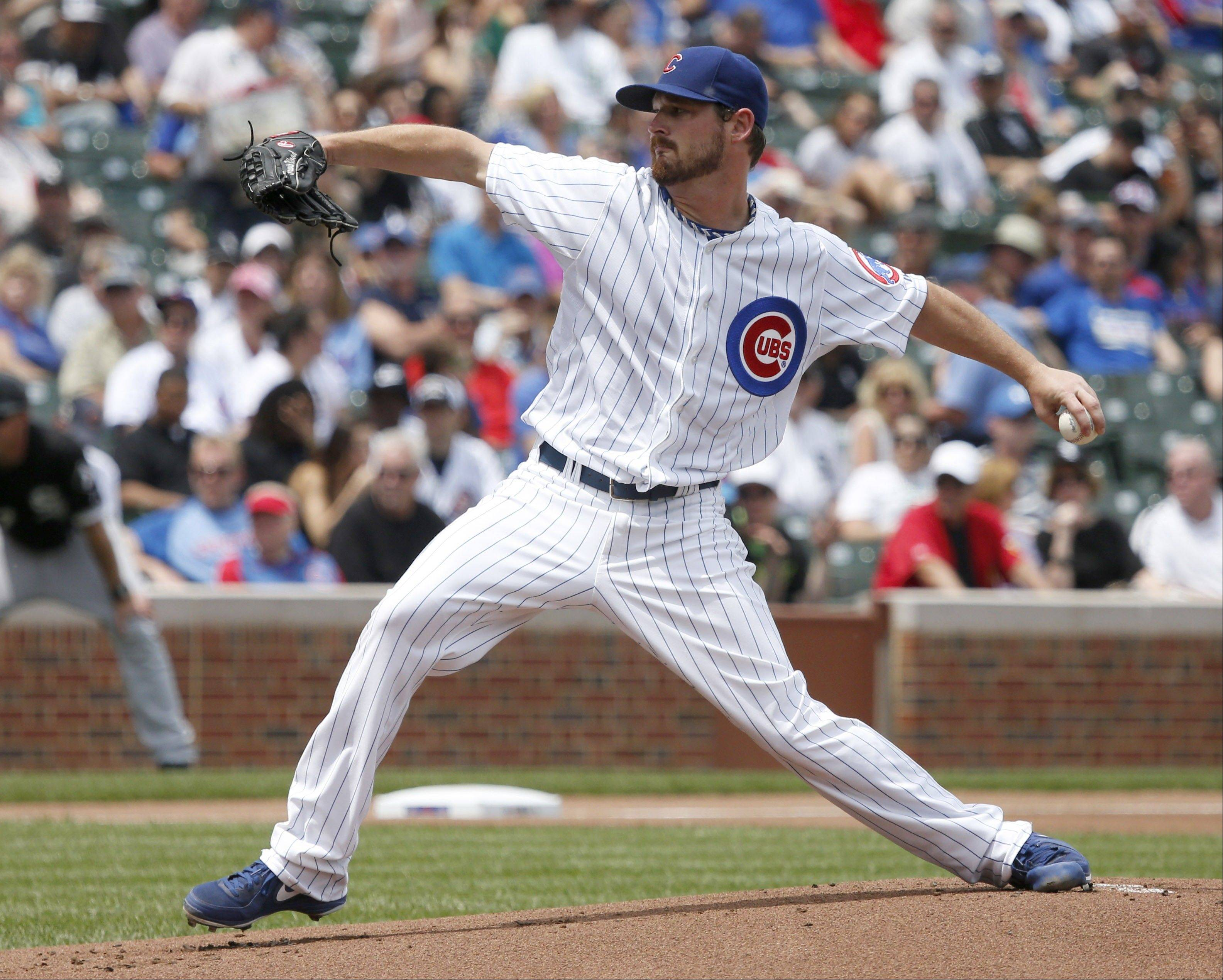 Chicago Cubs starting pitcher Travis Wood delivers during the first inning of an interleague baseball game against the Chicago White Sox Thursday, May 30, 2013, in Chicago.
