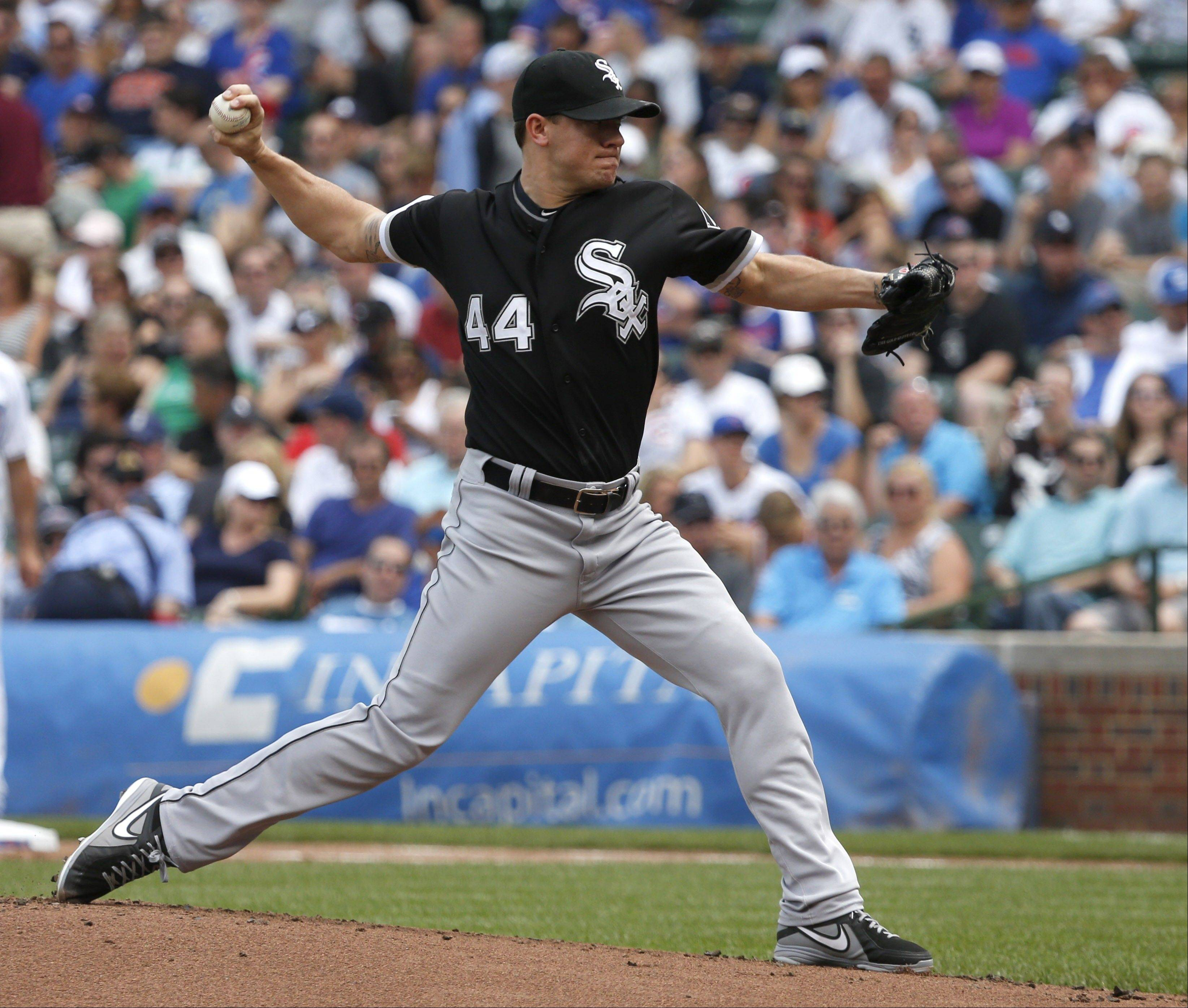 Chicago White Sox starting pitcher Jake Peavy delivers during the first inning of an interleague baseball game against the Chicago Cubs Thursday, May 30, 2013, in Chicago.
