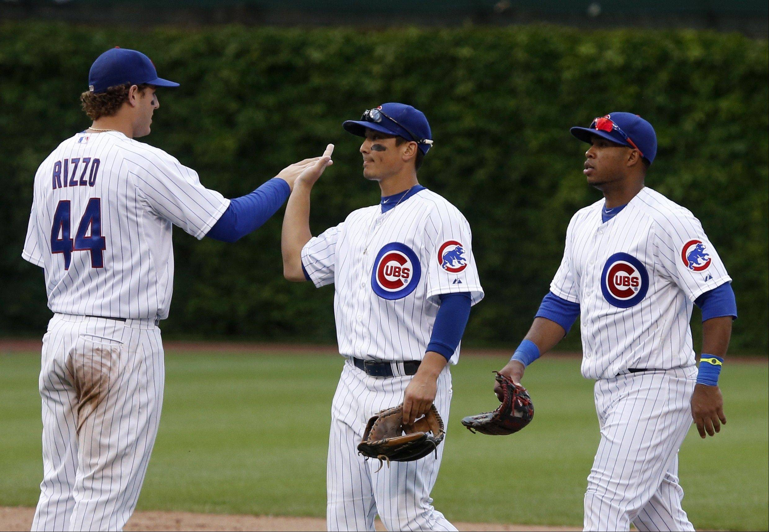 Chicago Cubs' Anthony Rizzo (44), Darwin Barney, center, and Luis Valbuena celebrate the Cubs' 8-3 win over the Chicago White Sox in an interleague baseball game Thursday, May 30, 2013, in Chicago.
